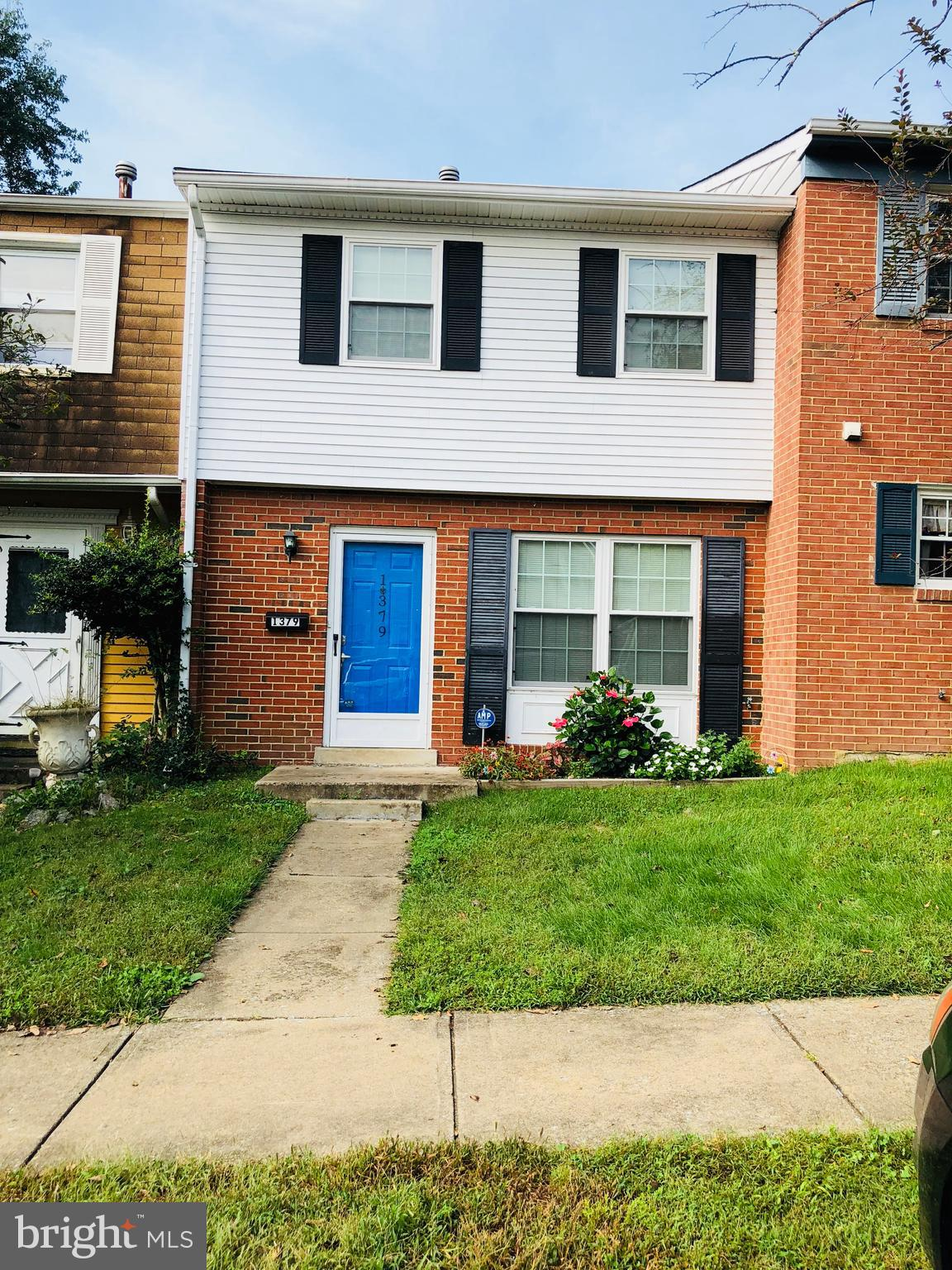 Terrific 2 level townhome features new floors on main + upper level.  Kitchen with updated counters & cabinets and new appliances. Living room has a sliding glass door leading out to a fenced yard with brick patio. Walk-in closet in master bedroom. Community pool! Assigned parking