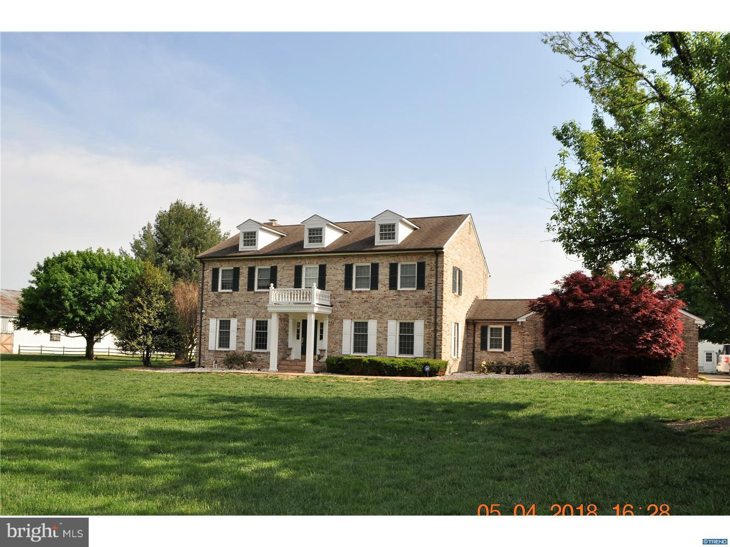 One of a kind Horse lovers Dream Property. This stunning 4 bedroom, 4 1/2 bathroom Colonial Estate home is located in the desirable Appoquinimink School District and is situated on 20 + acres of property that includes 2 sub-dividable parcels of 11 acres (tax parcel 1301800141 & 9.97 acres tax parcel 1301800142) that backs to State of Delaware wildlife refuge area. at the rear of the property is a beautiful pond perfect for sitting out and enjoying all the wildlife. This property has an inground pool, 6 stall barn that includes a spacious heated tack room with bathroom, washer & dryer plus a large run-in and a wash stall. Fenced pastures. There is a beautiful 80x168 indoor riding arena and well-lighted outdoor riding area with grass footing, a large workshop barn that includes 2 completely finished off garage spaces.  On the opposite side of the workshop building you will find four additional garage spaces for tractor/equipment storage. The workshop building also includes 2, efficiency apartments.  A detached two-stall heated garage is situated near the house.  Within the stall barn, there is a spectacular hay storage area with the most stunning wood frame building design you will find.  Words cannot describe all that this property has to offer and its stunning beauty.  Deer and wild turkey abound.  Trails in the 7 acres of woods.  Large fenced dog kennel and about 2 acres of invisible fencing.