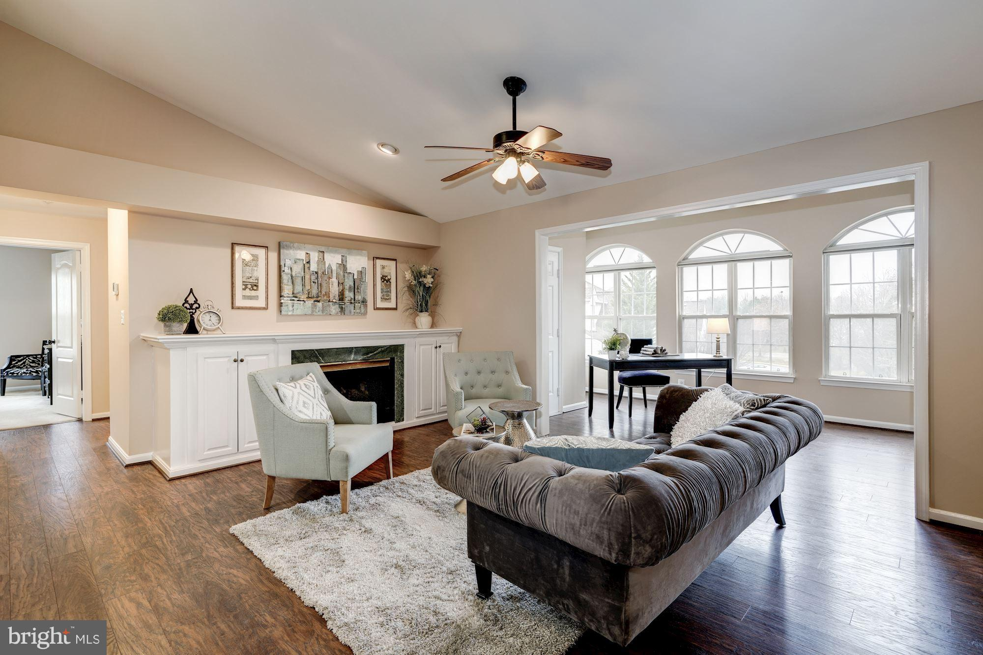 Gorgeous top-floor condo updated! Vaulted ceilings, 2018 water heater, 2016 HVAC, 2014 wood floors, gas stove and fireplace, two walk-in closets, storage unit, parking and much more. Near Kingstowne, Franconia Metro, VRE, 495 & 395, Wegmans. The community has two pools, jogging trails, tennis, volleyball, tot lots, club house, basketball courts all with a low $290/mo and $78/qtr condo fees. Nearby lake & cherry blossoms right outside your window!