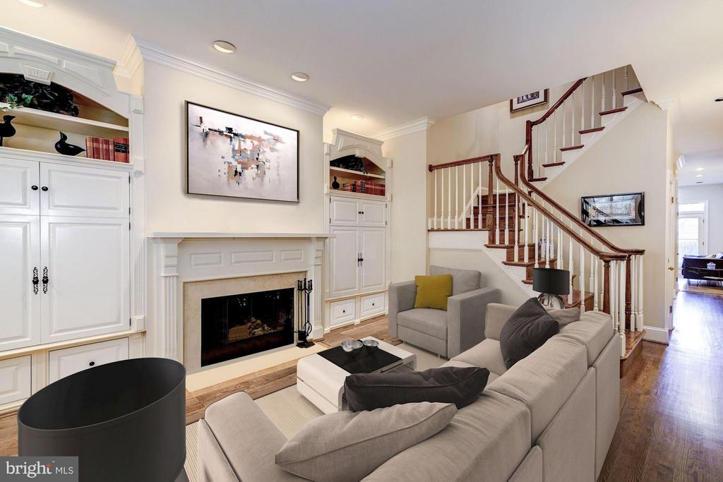 Most convenient DC location!  Ideally situated between West End and Dupont Circle, this 4 BR/4.5BA (including in-law suite) row house is within walking distance to Georgetown, the Central Business District, and two Metro stations. The living room features a bay window,  custom cabinetry and gas fireplace,  adjacent to formal dining room, and a large gourmet kitchen with access to a rear patio and two car parking.  A powder room completes this level. The third level features a bedroom with en-suite bath, an additional bedroom, and a hallway bath. Large windows provide abundant natural lighting throughout. The top-level features a huge Master suite with tall ceilings, a fireplace, private balcony, and luxurious master bath with dual marble vanities, walk-in shower, and a Jacuzzi tub. Additionally, the basement level is designed as an in-law studio with a full bath, kitchenette, W/D hook-up, and a separate front entrance.   Easy walk to top restaurants, numerous health and sports clubs, Rock Creek Park, Kennedy Center, GWU, Trader Joe's and other fine establishments.     Note that this home was fully re-constructed in 1988, allowing for a more solid structure than most of the period row homes in the area.