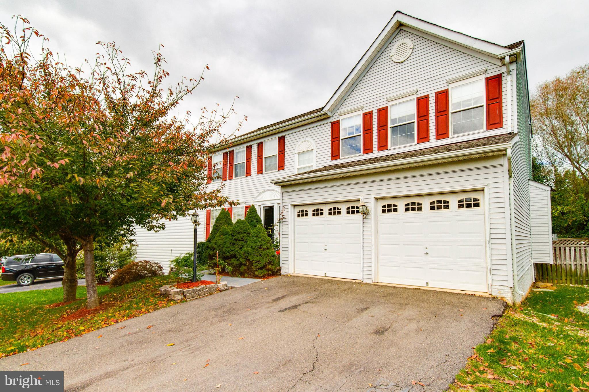 Perfect for anyone! Living in this generously spacious 3 lvl house should be easy! 2,152 sqft on a lot of 7,701 sqft featuring 4 beds, 3.5 baths, finished bsmt w/2 bonus rooms priced to sell quickly!Enjoy gatherings in the living area graced by a fireplace and connected to the rear deck in the huge backyardGreat location near shops, dining and more. Very convenient to major roads and highways
