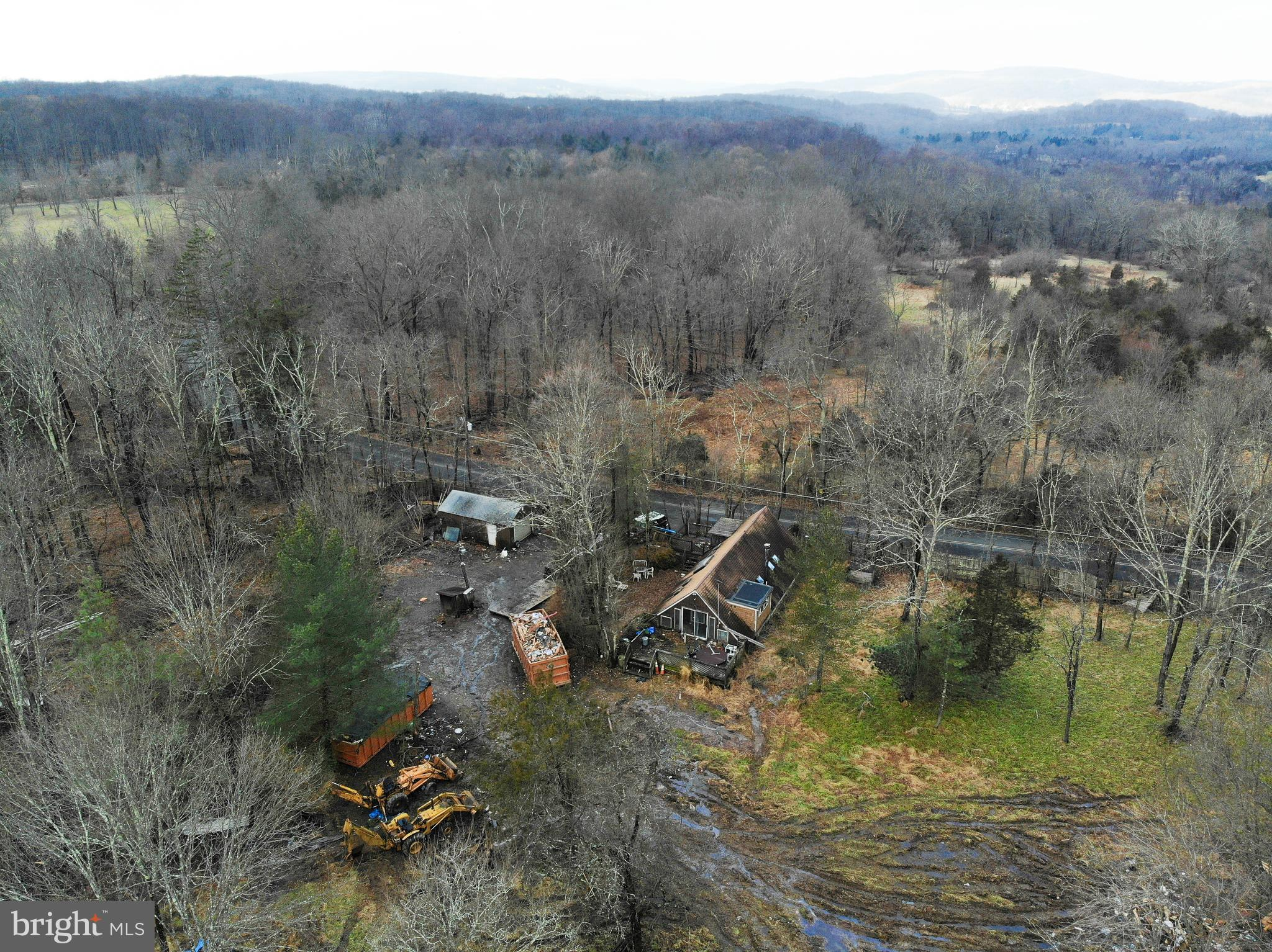 ATTENTION ALL INVESTORS AND HANDYPERSON. Home located on 2.11 acres of open land. House needs major rehab or tear it down and build a beautiful estate. Priced below market value.