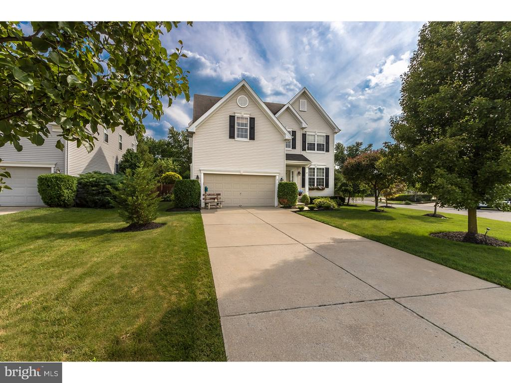 "Located on a cul-de-sac in Mount Laurel exquisite home is move in ready. A corner lot giving privacy and room. From the moment you enter this gorgeous home done by the owner with impeccable taste you will feel the warmth, and comfort to call this your home. Large tile foyer extending into the kitchen with surrounding hardwood floors. The kitchen boasts 42"" cabinets, stainless appliances, granite countertops and a custom backsplash. A finished basement with an office that is currently used as an office/hobby room. Also, the entertaining area has a bar. The second floor of this home is complete with four bedrooms. The master bedroom with walk in closet, full bath with a garden tub. Photos reflect purple paint. The master has been painted a neutral color. Three additionally nice size bedrooms and a full bath complete the second floor. A two car garage, nice yard and easy access to major highways. Major shopping within minutes. It is in the great Mount Laurel School system. Call today for you appointment, and get in before the school season begins."