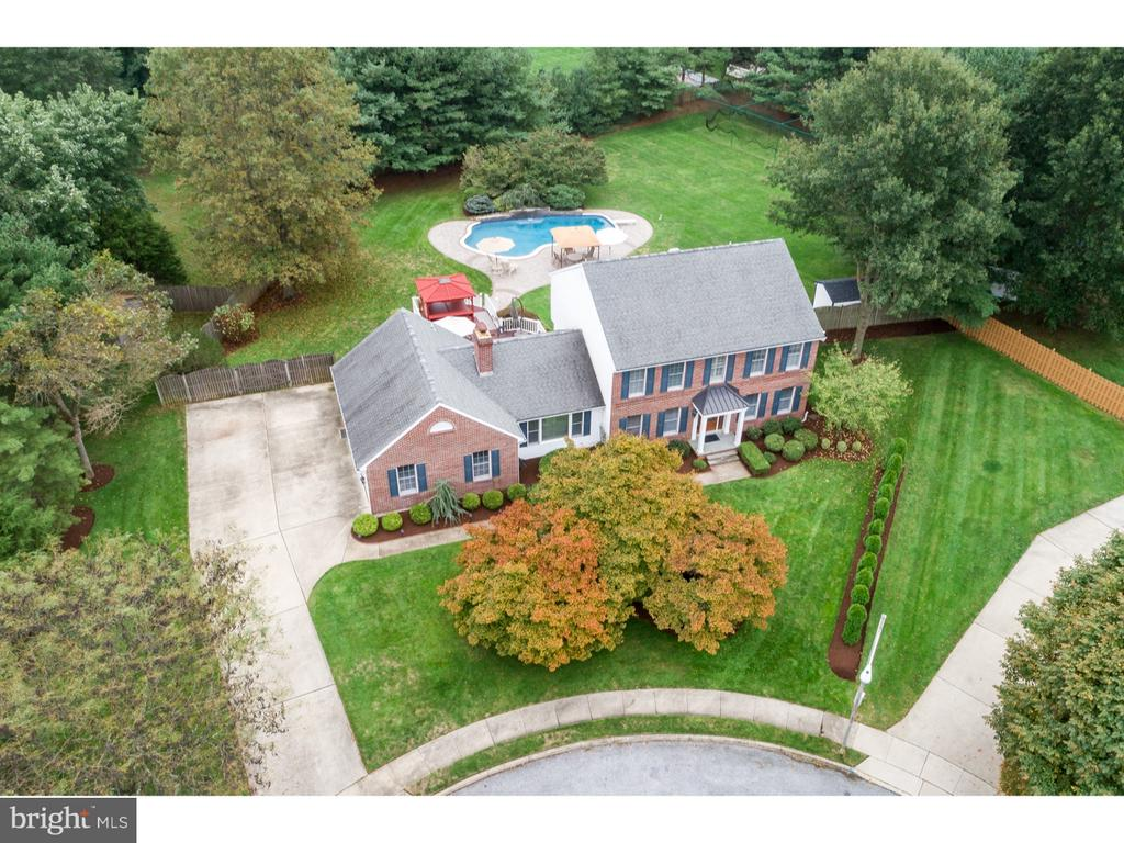 Welcome to Paradise...From the moment you pull up to the cul de sac setting instant relaxation comes about. The curb appeal of this professionally manicured .78 of an acre grown, to the magnificent brick front home with a custom porch, and new stately front entrance is exhilarating.  An over sized two car garage with entry door compliment the side driveway. Hardwood floors are found throughout most of the home. The first floor layout has a formal living room, formal dining room, office, large laundry, a full size family room with a brick wood burning fireplace.  All freshly painted in a neutral tone.  The kitchen has been updated with tile floors, black appliance package, center island with a cooktop, custom tile back splash, and dark maple cabinets, and Corian countertops. The basement is fully finished with still plenty of storage space. All done in a neutral tone.  When you make your way to the upstairs you will find hardwood floors throughout and neutral paint.  All the bathrooms have been updated.  Plenty of closet space as well.  Saving the best of the home for last. A large fenced backyard with a Guinite inground pool, water fall are placed in the perfect location. A tiered deck with a hot tub, and bar stools surrounding the hot tub.  Out in the far back of the yard sits a full batting cage. Yes, a full batting cage with a pitching machine. Other fine features that must be mentioned are new gutters,security system, sprinkler system, newer two zone heating and air conditioning, hot water 2008, newer driveway and more.  Located close to shopping, schools, and easy access to major highways for a quick twenty minute drive to Philadelphia.