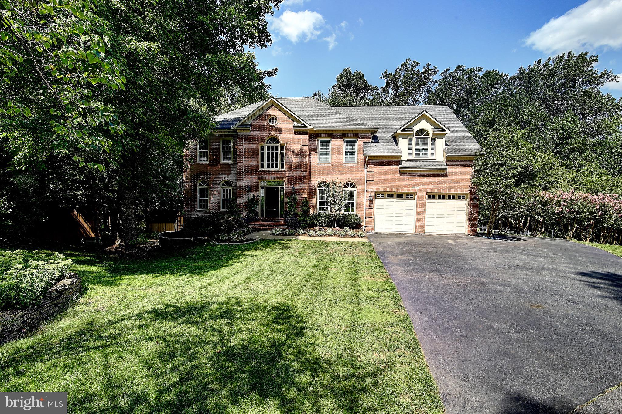 **Sophisticated and Pristine** all brick-front Colonial in desirable Reston community nestled on a quiet and secluded.....nearly half acre lot! This impeccable/ 6 bedroom house features a  dramatic 18' two story foyer with spiral staircase, gleaming hardwood flooring, detailed custom moldings, and fresh paint throughout. The sun-filled family room showcases 18' two story floor-to-ceiling custom textured stonework, gas fireplace, new palladian windows and skylights. Gourmet kitchen has stainless steel appliances, newly updated refaced cabinets, granite counter tops, convection oven, breakfast room and new windows overlooking the fabulous pool and picturesque  setting. There are 4 generous sized bedrooms on the upper level with 3 full bathrooms  The owner's suite is expansive; has 2 walk-in closets and wood floors. The newly remodeled luxurious master bath has a large walk-in Roman shower surrounded by gorgeous Travertine and mosaic custom tiles. The modern and sleek free standing soaking tub, and towel warming bar promises a Relaxing spa experience. The fully finished basement walks out to your glorious retreat, has a large family friendly room that could accommodate exercise and/or media/game space; has two additional bedrooms, full bath, and a ultra grand storage closet. This warm and inviting house offers a tranquil, premium lot with your own private backyard oasis. The coveted in-ground swimming pool has a new motorized pool cover, built-in BBQ pit, extensive front and back landscaping, and a fully fenced-in yard backing to trees... an entertainer's dream!All new doors and energy efficient windows - replaced in 2016, New roof- August 2018. Conveniently located within 5 min from Reston Town Center and within one mile to the new Wiehle/Reston Metro Station. This house is sure to go fast!