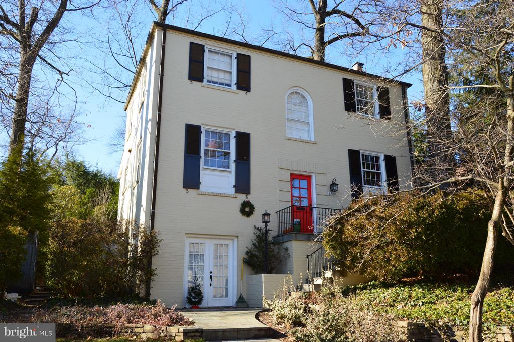 Elegant Center Hall Colonial is in the Town of Chevy Chase. This well maintained home features moldings and custom built-ins throughout, wood buring FP w/gorgeous wood floors. Other highlights include; a renovated eat-in kitchen, a first floor den/study, a cozy finished lower level w/ full bath and bedroom- Three permit parking spaces directly in front of the house. Location can't be beat! Park your car and  take a short stroll to Metro, Trader Joes, WSC Gym, Bethesda Rowe for great restaurants, shopping and entertainment. Don't miss this one!
