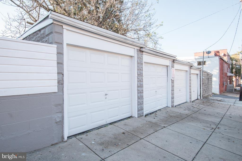 4 garage spaces all with income potential! Currently 3 spaces rented. Two month to month rents $125/mo and one garage bay rented at $95/mo for a year.