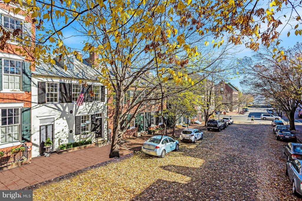 City living in the heart of Old Town w/ real 2 car parking ! Well maintained historic home on sought after cobblestone street.Steps to the waterfront!4 BR, 3.5 BA plus large unfinished basement offers more that 3000 Sq ft of space. Rare large private garden  and brick patio for entertaining  Large family room off back of home opens to patio Spacious 2 car parking behind patio.White kitchen with gas range.Beautiful hardwood floors on main and upper levels New carpet in Attic BR (w private bath)Lots of closet space and storage