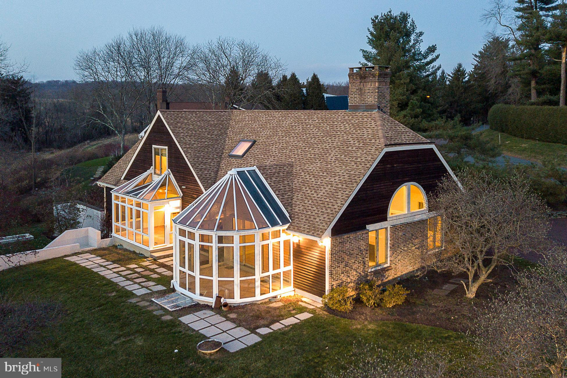 A rare gem in a coveted Western Section setting, this exciting Hillier home impresses with the clarity of natural light, the seasonal color of a romantic sunken garden and backing meadow, and sidewalks all the way to downtown. Vaulted ceilings and hardwoods energize a flexible layout that can live large or small, depending on your needs. A wonderful flow connects a soaring library and living room, a dining room fit for a feast, and a peaked, glass-wrapped solarium that provides sunny pleasure year-round. The eat-in kitchen's breakfast room delights with long views of the garden and a Mountain Lakes meadow.  A 1st floor master features an organized walk-in closet and private en suite bath; 2 more sun-filled bedrooms upstairs share a skylit bath and a fantastic loft space. The expansive, walkout basement has potential for finishing. Set in The Glen, where homes rarely come to market, this well-priced home offers manageable taxes and a stroll-away location from Nassau Street, Mountain Lakes Preserve, and area recreation trails.