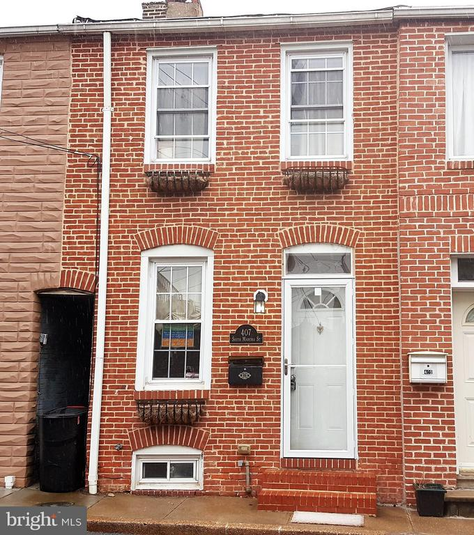 Renovated rowhouse with Living and Dining Rooms, Beautiful Kitchen with SS Appliances & Granite, Pantry, Hardwood floors. Main level Powder Room, Finished Recreation Room in Basement, Storage Room, Floating Staircases, Brick Walls, Full Bath with Ceramic Tile floors & tub surround, Vaulted Ceilings and newer Carpet. Natural Light, Private Patio. Walk/ride minutes to waterfront, close to Johns Hopkins, one street from Patterson Park.