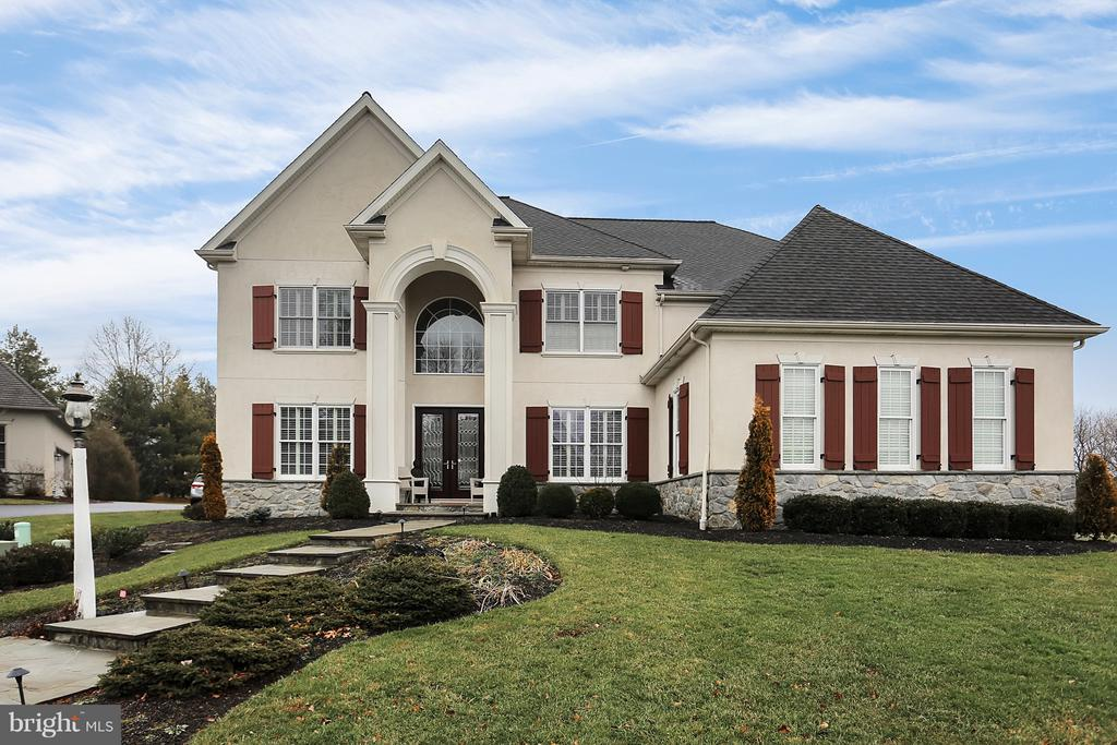 Located in Manheim Township's premiere gated golf community of Bent Creek, this timeless design was carefully crafted with lavish finishes inside and out, including flagstone walkways and three patios; two story family room with custom fireplace and built in entertainment center; elegant outdoor fireplace; custom Manny Beiler floor-to-ceiling kitchen cabinets inside a chef's kitchen.