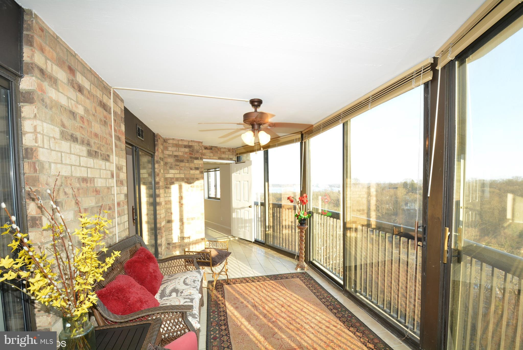 Single family feel, with condo perks! You will love the tree house feel from the huge enclosed balcony with views of the river, National Harbor and trees. Spacious 1525SF inside with 2 bedrooms (both with access to balcony) plus a den off the living room. Unit comes with garage space and storage space as well. Just steps from the community center, which offers loads of amenities; you will enjoy the resort feel here! Small town ambience with variety of social activities & events. 24/7 monitored security; 36+ wooded acres; very pet-friendly; full-service restaurant, indoor pool and outdoor pool, tennis, bowling, party rooms, hair salon, free shuttle to Metro and shops. Located 2 lights from Old Town, and 20 minutes from Crystal City (by Metro yellow line or driving, it's the same!) so great for Amazon!