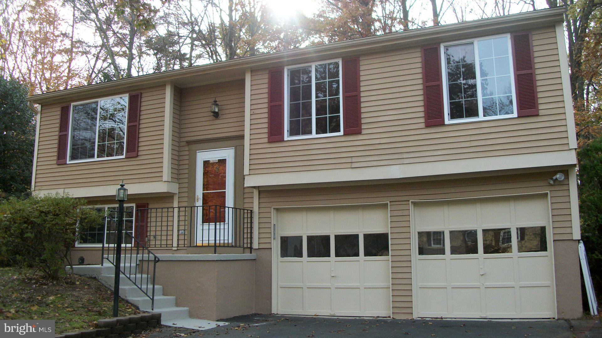 Recently Renovated house in the GREAT Newport Neighborhood,  NEW Hardwood Floors on Main. NEW Kitchen. 2 Car Garage. Walk to Leesylvania Elementary. Located next to Julie Metz Wetlands Park and Preserve with walking trails and over the water Boardwalk.  Leesylvania State park practically next door with Picnic, Trails, Fishing, Boating and so much more.  Ferlazzo County Center, Eastern PWC Police District office 2 miles away.  POTOMAC MILLS and STONEBRIDGE with WEGMANS less than 2 miles away.  Commuter Train (VRE) Rippon Station and RT 95 Exits and RT 1 are just moments away.  Located mid way between Quantico Marine Base and Fort Belvoir Army Post.  Federal Contractors located 25 minutes away!   This is one GREAT LOCATION and a house to match at a price you can afford.  Own it for less than rent!  Go see it TODAY!