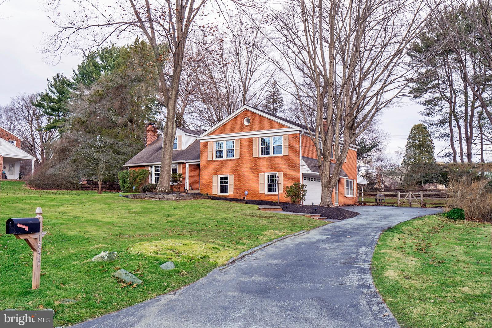 Lovely all brick Colonial Split-level located directly across from Valley Forge Park National Park (3,500 acres with jogging, walking and biking trails plus many other recreational uses)! Walk up the flagstone walkway to the covered front entryway. Through the front door you will be welcomed by the  entrance foyer with double coat closet. The living room features a fireplace, built-in bookcases, and a bow window with sunsetting views of the park. There are hardwood floors throughout and a formal dining room with chair rail and crown molding. The kitchen features QuakerMaid cherry cabinetry, Corian countertops, newer stainless-steel appliances including a double oven, Pella picture window and seating that faces the fenced-in backyard. The lower level offers a family room with an additional brick fireplace, outside exit to covered porch, laundry, access to 2-c garage and yes, there is a basement unlike many other split-level homes. The 2nd floor features a Master bedroom with full bath, stall shower and a walk-in closet; two additional bedrooms and hall bath complete this level. The 3rd floor has a large bedroom and access to the attic for additional storage. Other great features include: a Honda 6800watt generator, alarm system, french drain & sump pump plus much more. You must see this beautifully maintained home in a perfect location.