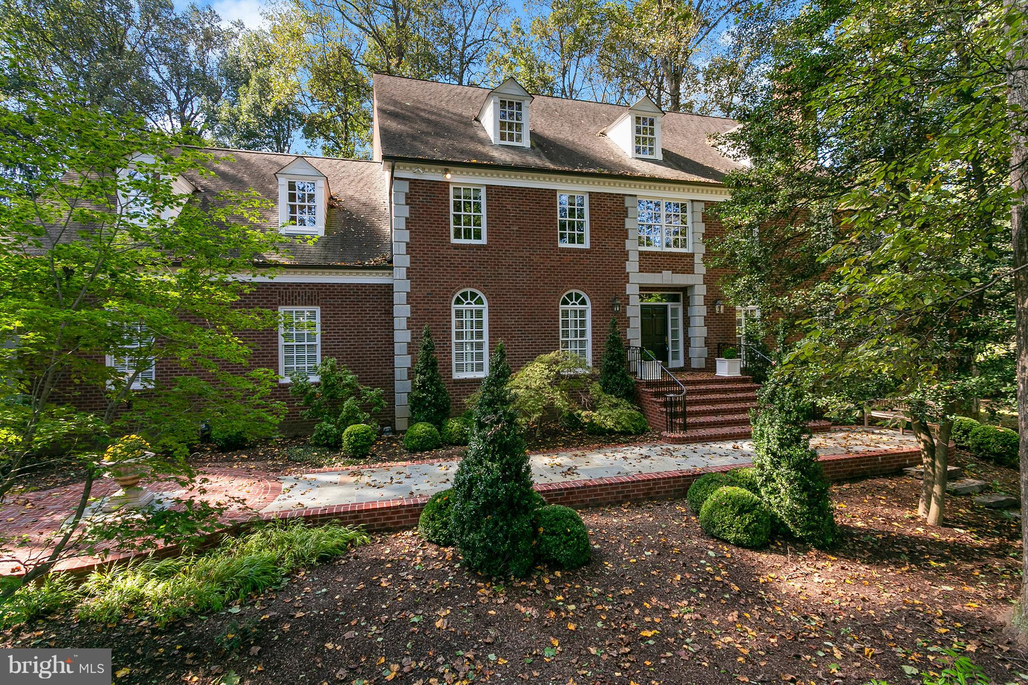 Beautiful & private custom built Colonial in the heart of Oakton. 4 levels w/ 5 bedrooms on the upper level, 4th floor bedroom & playroom/homework space. Basement features in law suite, movie room, huge wet bar, pool table - amazing for entertaining. Huge screened in porch overlooking trees. Flagstone walkway & porch, Trex deck. Serene 1.7 acre lot on quiet street but minutes to 66 & Vienna Metro!