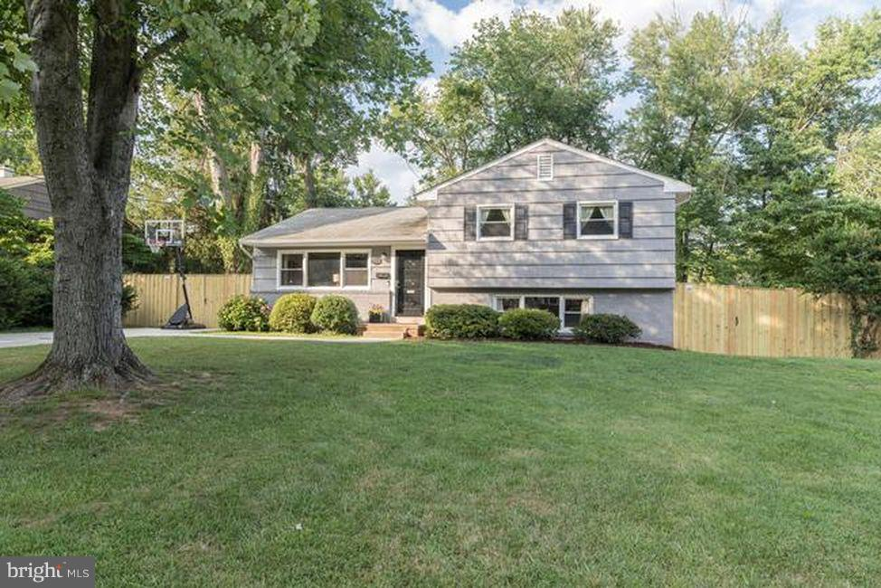 Do not miss this opportunity to live in the Town of Vienna!  Open 1/19 & 1/20-1 to 3pm.  Offers reviewed Tuesday 1/22.   This charming split-level is ready for a new owner. Situated on a quiet street in Vienna Woods, with large deck overlooking fenced yard. Beautiful 5 bedroom, 3 full bath home with addition.  Hardwood floors on main and upper levels.  Crown molding and chair rail. Addition has given way to expanding two great areas: a large master suite with a beautiful bay window overlooking the backyard and large lower level with separate entrance leading to the backyard.  Windows and sliding glass doors make for a bright open sunlit kitchen with SS appliances and new countertops.  Kitchen leads to the deck and fenced backyard perfect for fun and entertaining.  Upper level with spacious master suite complete with front loading washer and dryer. New master bath with marble counters.  Private door in master also leads to the deck.  Three additional bedrooms on the upper level, including a second full bath with great counter space.  Lower level with new carpet and paint provides great space with a rec room, fifth bedroom, a third full bath, and an additional room as a  playroom/office with refrigerator and sink. Close to shopping, schools, parks, and 1.5 miles to Nutley Metro.