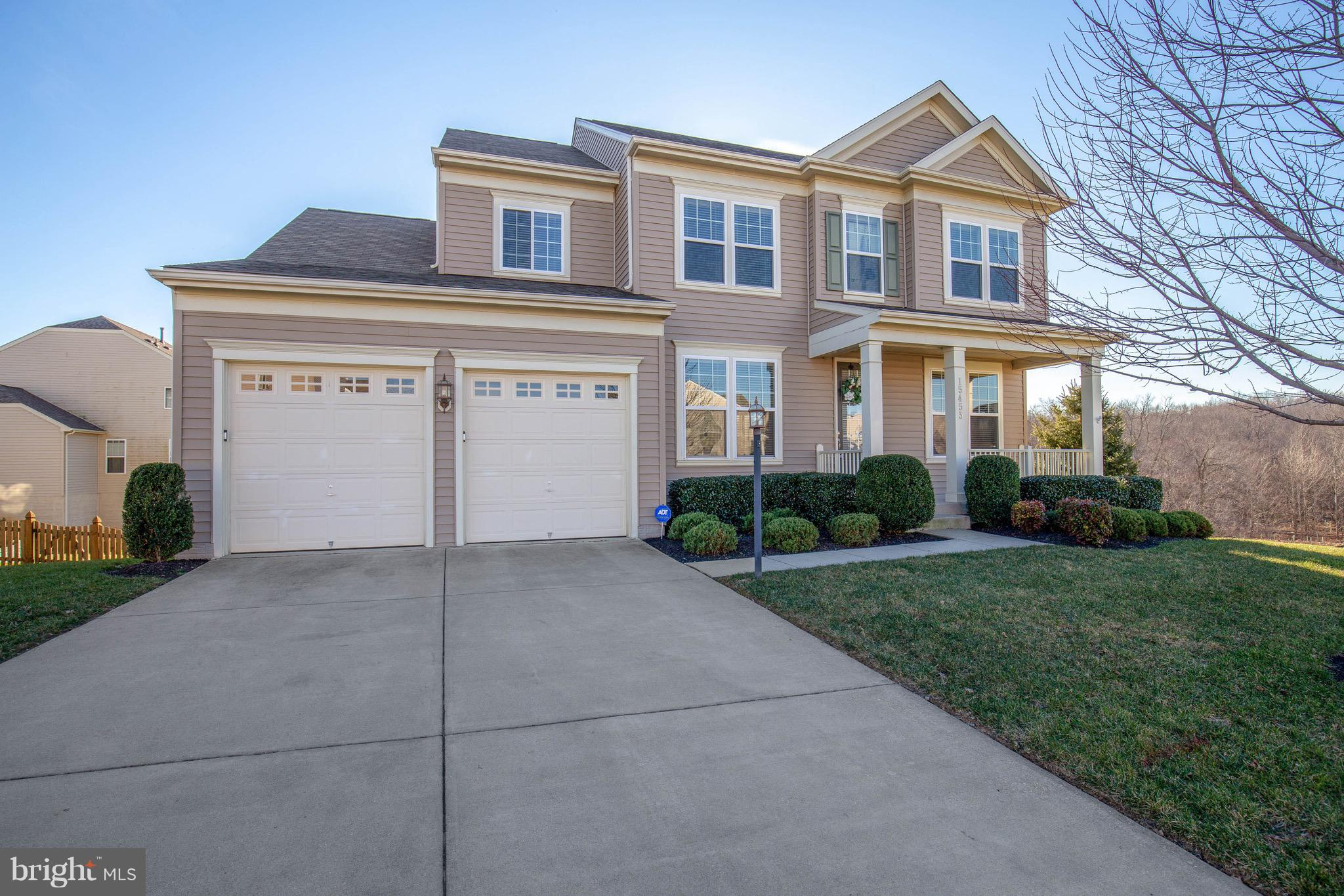 This home is priced to sell!  Gorgeous Carey model by Stanley Martin!  Nice open floor plan with beautiful engineered hardwood floors, huge gourmet kitchen with extra large island.  This kitchen has an incredible amount of cabinets and large pantry.  You'll love having a wet bar right off the kitchen that leads to the dining room with beautiful crown molding!  Kitchen has huge eat in area that leads to the family room with fireplace.  Upper level has master bedroom suite with tray ceilings, two large dual walk in closets, and luxury bathroom with separate shower, soaking tub, and dual vanities.  What I love about the upstairs is that this home is equipped with an upper level laundry that's really spacious!  The upper level also has 3 full baths which is an awesome feature to have.  The second bedroom has its own private bath.  The absolute best part of this home is the exterior.  It comes fully equipped with a spacious front porch and a breath taking composite deck with pavilion so you can enjoy the scenic view.  This home is an entertainers dream!