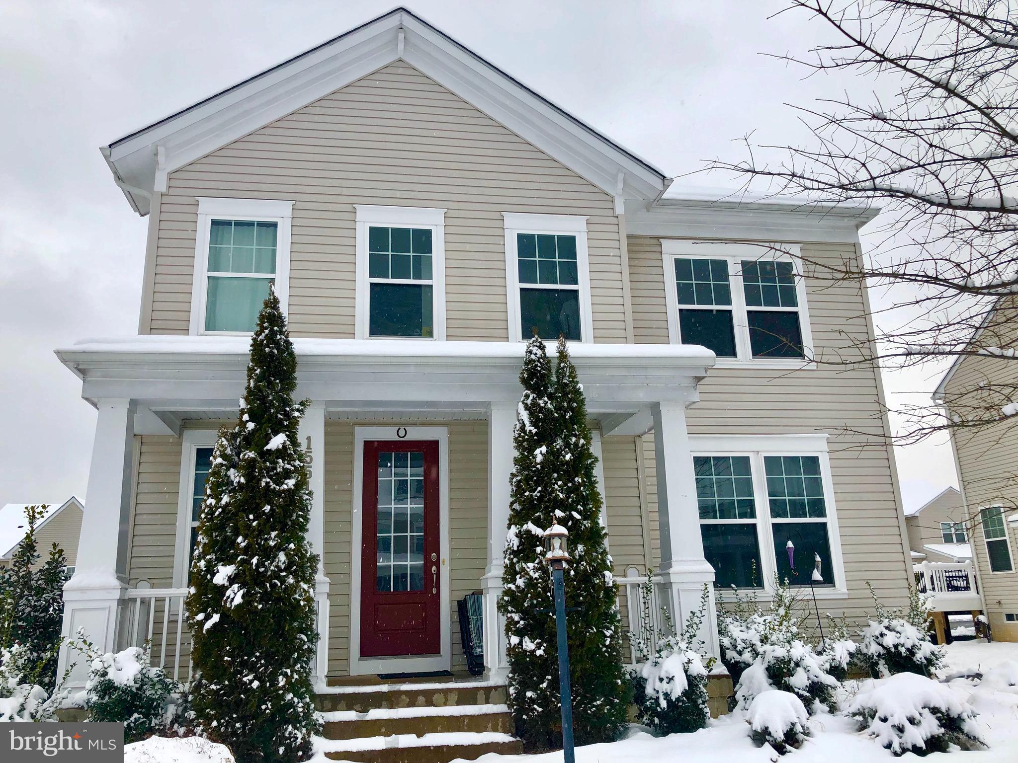 Hope Hill is a picturesque community in Prince William County that offers wonderful amenities. A 22 acre community park, walking trails, pool and clubhouse. Zoned for the highly sought after Colgan H.S. and Wilson Elementary school. The Embrey home welcomes you with a front porch that walks you into a open floor plan, kitchen with tray ceiling, granite counters, island bar. Get cozy in the connecting room with a fireplace in the family room. Upper floor has Master bedroom suite with tray ceiling, enormous dual walk-in closets and luxury bathroom with dual vanities. Impressive en-suite bathroom in the guest room , extra large laundry room  adjacent to other bedrooms. Huge walk out basement with full bath and optional theater room. The backyard is fenced and has a deck for outdoor grilling. Near major commuter lots and shopping.