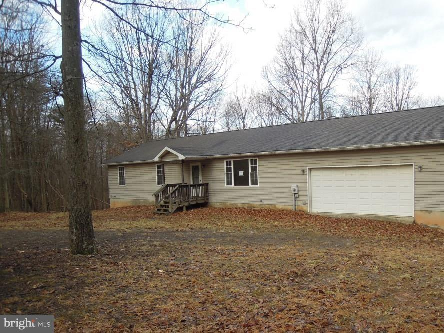 3 bedrooms, 2 bathrooms rancher situated on approx.  8.26 acres, full unfinished basement, kitchen/dining room combo, large deck,  detached garage.