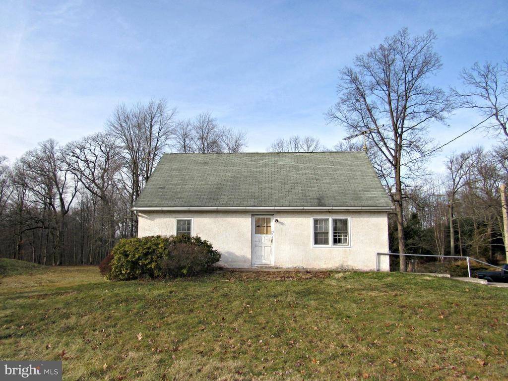 """Great location on nice 1.57 acre lot. Home needs your TLC and being sold """"as is"""". Sand mound thought to be approx. 15 years old."""