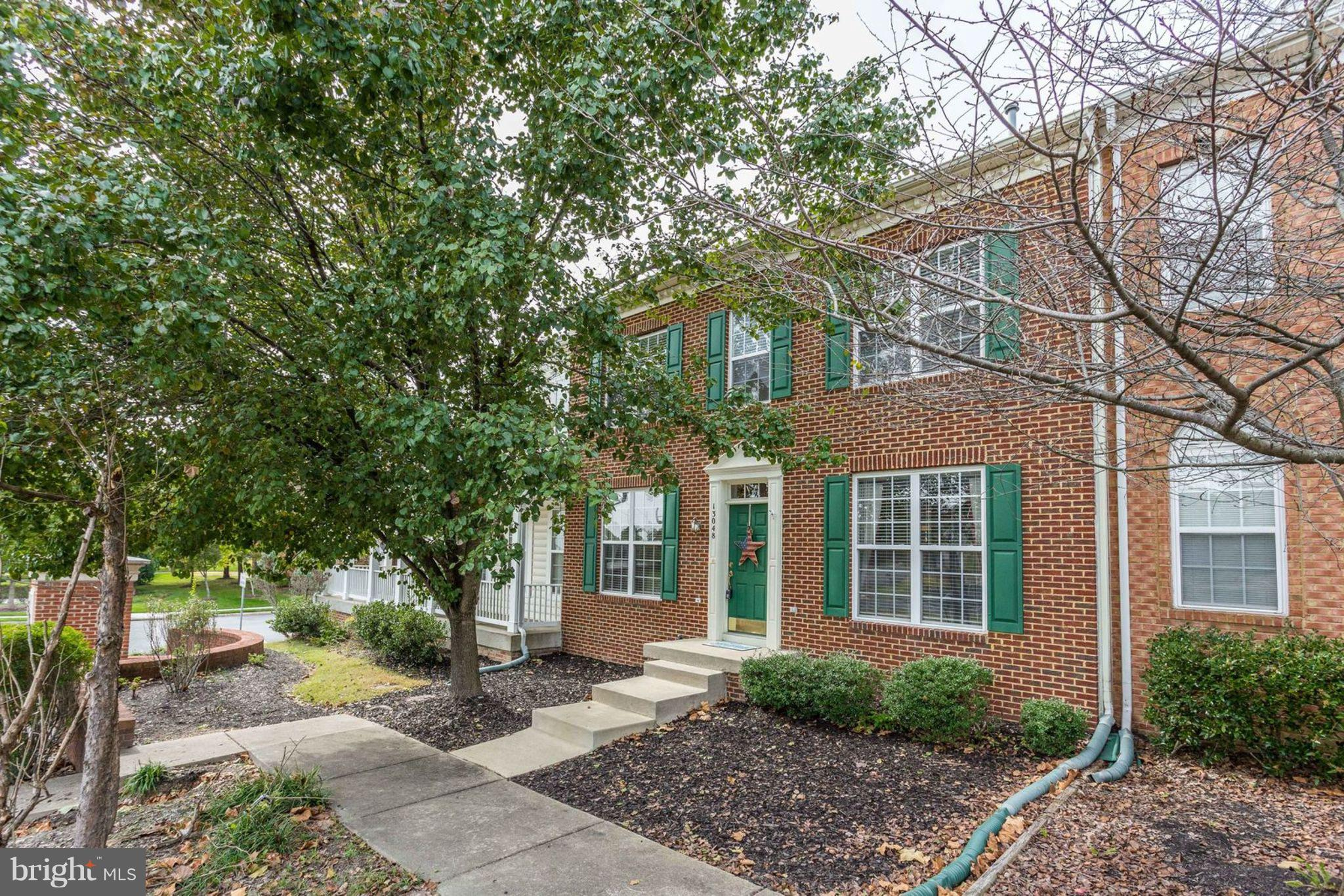 Beautiful MOVE-IN READY brick front townhome! Lives like a single family! Two car garage. Oversized kitchen, family room with cozy fireplace, main level office, 4 upper level bedrooms. New HVAC, appliances and paint. Great commuter location, this light-filled home is close to the Bus and Commuter Lot.