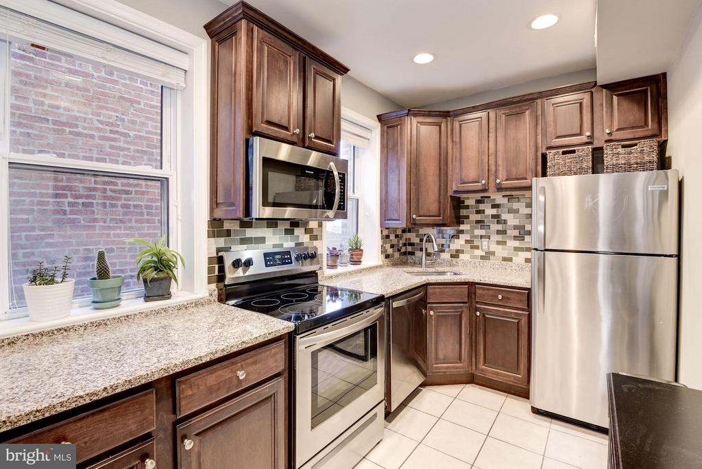 Motivated Seller! Move Right In! Lovely, 1BR Columbia Heights condo is ready for you. Large custom kitchen with granite countertops,  stainless steel appliances (2017), a breakfast bar and two windows. Lovely living room with wonderful wood floors and a large window. Delightful dining nook, full bath with jetted tub and newer HVAC (2017). Bodacious bedroom is light and bright with copious closets and entry to private, covered patio. Close to shops, restaurants, bus routes and Metro.