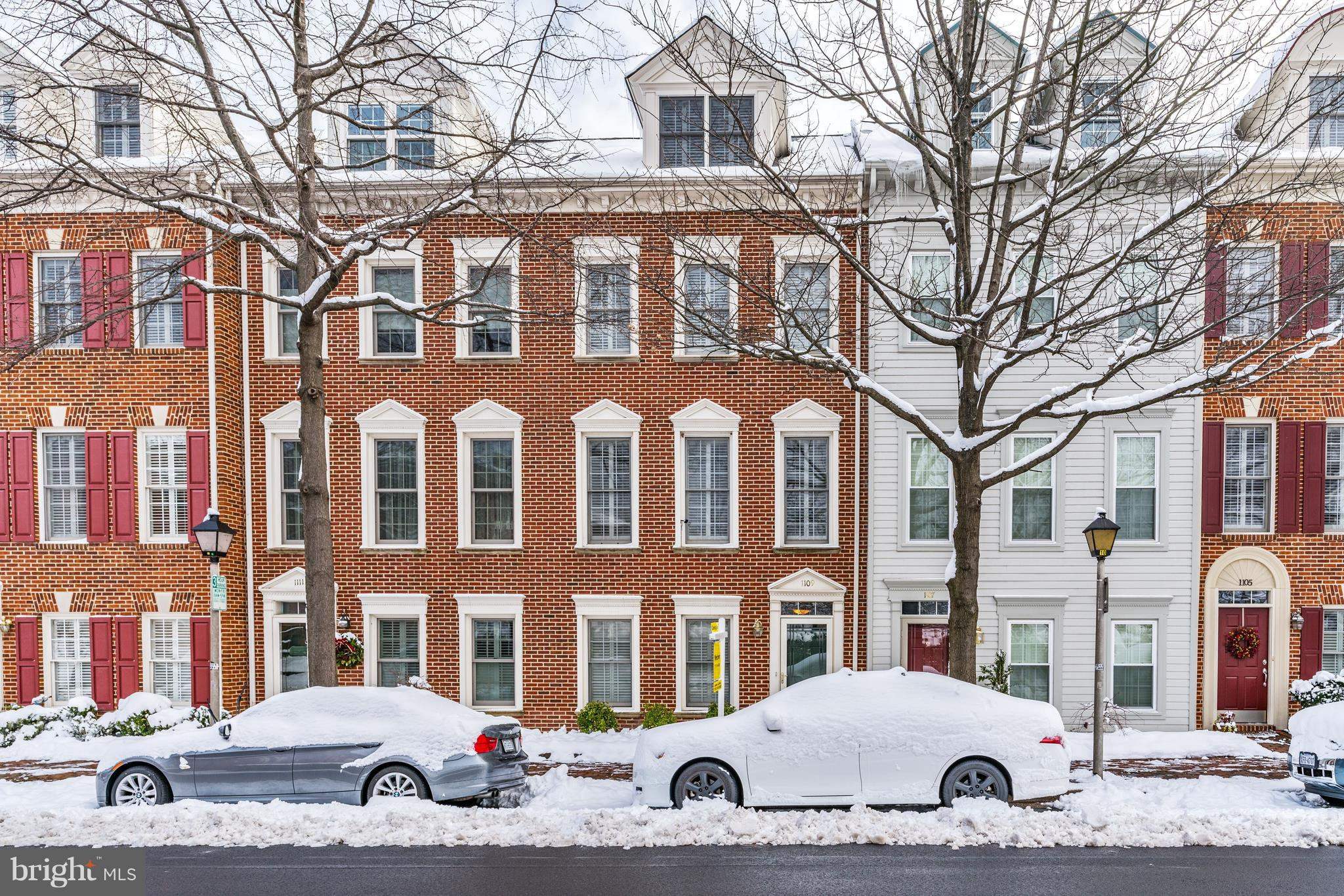 This is a four level brick garage townhouse with $40,000 of owner improvements and upgrades located just 2 blocks from the Potomac and 2 lights to the airport and DC.   On the main level, you can enter the foyer  from the rear-load garage or from the front door.  There is also a powder room and a den/office on that level.   Upstairs is the gourmet eat-in kitchen with granite countertops and stainless steel appliances.  The newer sliding glass door has louvers between its panes of glass which allows bright light to enter when opened or privacy when the louvers are  closed.  The door opens onto the deck for convenient grilling and casual dining.   Also on this level is the combination dining/living room which has  a gas fireplace located between the two built-in bookcases.  Plantation  shutters are on all the windows of all levels of the house.  Hardwood floors are on both the main and first levels.  Upstairs is the en suite master bedroom and bath.  The walk-in closet has been redesigned by California Closets.  The second bedroom also has a walk-in closet.  This level has a second full bath and a convenient laundry area with ample storage above the washer and dryer.  The top level has a second guest bedroom and the third full bath.  Between the guest bedroom and bath,  there is a comfortable family room and three deep storage closets.  There is a fourth closet in the full bath.  Both top levels and the stairs have deep carpeting with upgraded pads.  The list of owner improvements and upgrades include a replaced hot water heater, new roof, new HVAC, wood deck replaced and stained, a replaced storm door and sliding glass door, refinished hardwood floors and PVC wood on dormer windows in front.Hearthstone Mews is a small community of 29 townhomes located in north Old Town close enough to the shops and restaurants to walk to them but not close enough to experience much traffic.