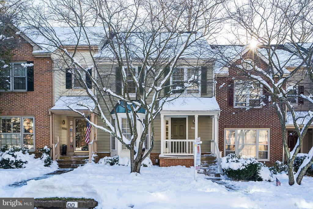 Open House, Sunday 1/20 2-4 PM. Exceptional opportunity in sought after North Reston location. Adorable covered entry will welcome you home everyday. Move in condition and lovingly maintained by current owners. Large Bay window adorns the updated kitchen with granite countertops, recessed lighting, and stainless steel appliances. Main level boasts exceptional hardwood floors, fireplace, and deck. Master suite offers walk-in closet, vaulted ceiling, large bathroom and second level loft. The loft is open and bright with skylights and is perfect place for a home office, nursery, library, or exercise area. Finished walkout lower level with full bath, fireplace, huge storage area/workshop, and second deck/patio with ample room for outdoor entertaining or to simply relax and enjoy the peaceful views. Offering 3.5 baths and the possibilities to easily add one or more bedrooms if desired. Easy walk to North Point Village Center.