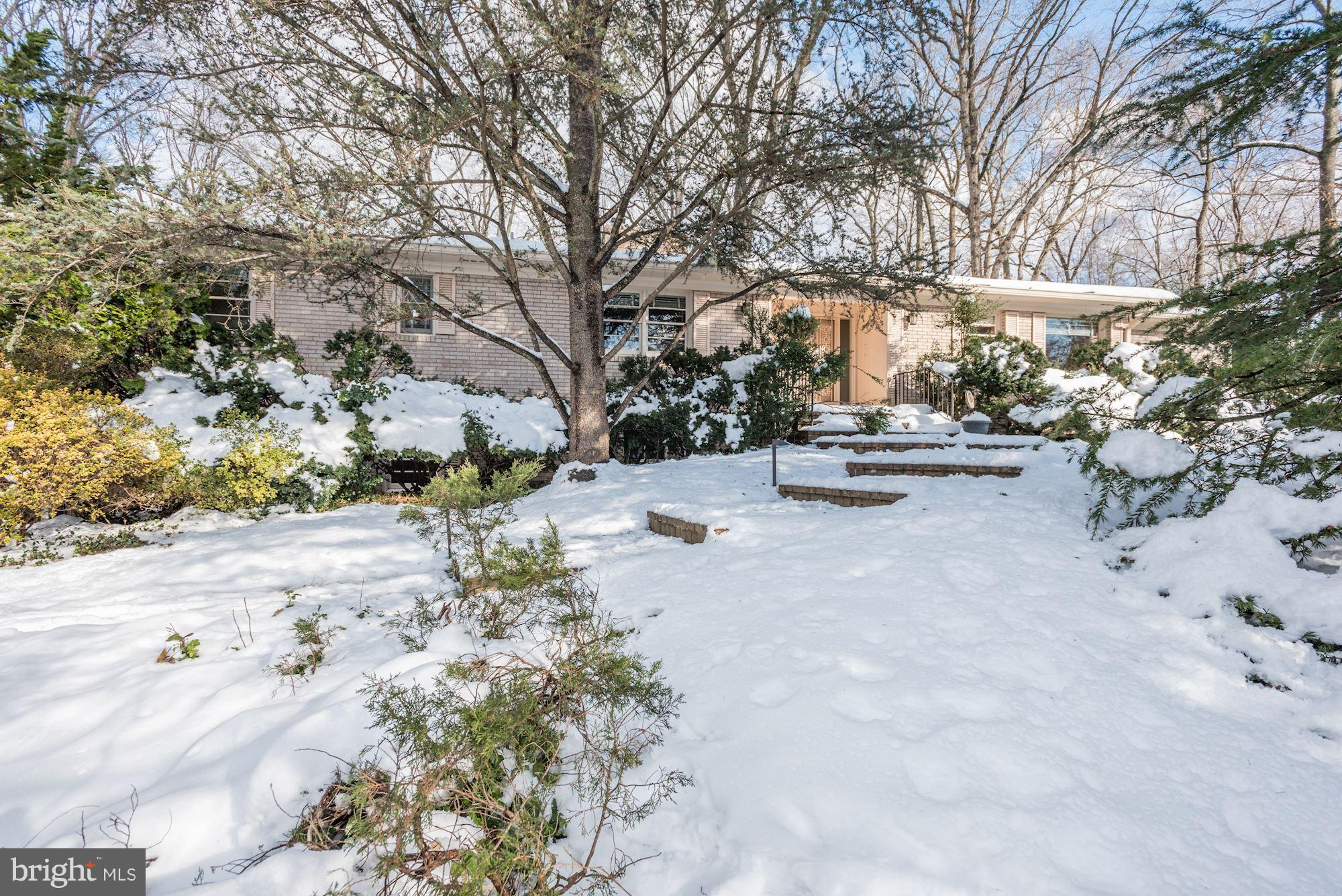 Great opportunity to make this lovely home your own!  Sited on a beautiful .52-acre lot in sought after Chesterbrook Woods - only 1 light to DC! Not your typical rambler, the home throughout boasts exceptional spaces with amazing potential! Large and light-filled living room with bay window overlooking backyard. Sizable Sun Room addition. Large Kitchen with substantial cabinetry and counter space and eat-in area. Lower level walk-out with large family room and wood burning fireplace. 2 additional bedrooms in the lower level. 1.5-car side-loading garage. Minutes to DC and Tysons with easy access to Reagan and Dulles airports. Don't wait to see this home! Sold As-Is.