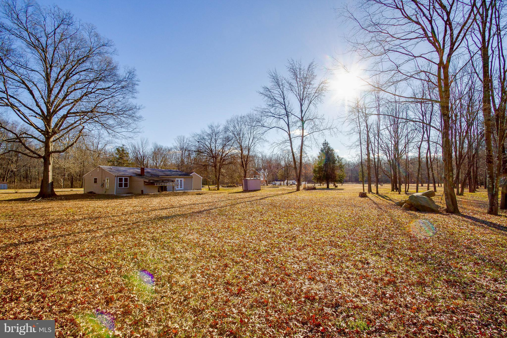 Location, location, location. Near Kingstowne, Beltway and metro. Rarely available 3.52 ACRES - great lot for development - NO EASEMENTS OR COVENANTS AND NOT IN FLOOD ZONE.  Quaint studio home with hardwood flooring, newer appliances - meticulously maintained.
