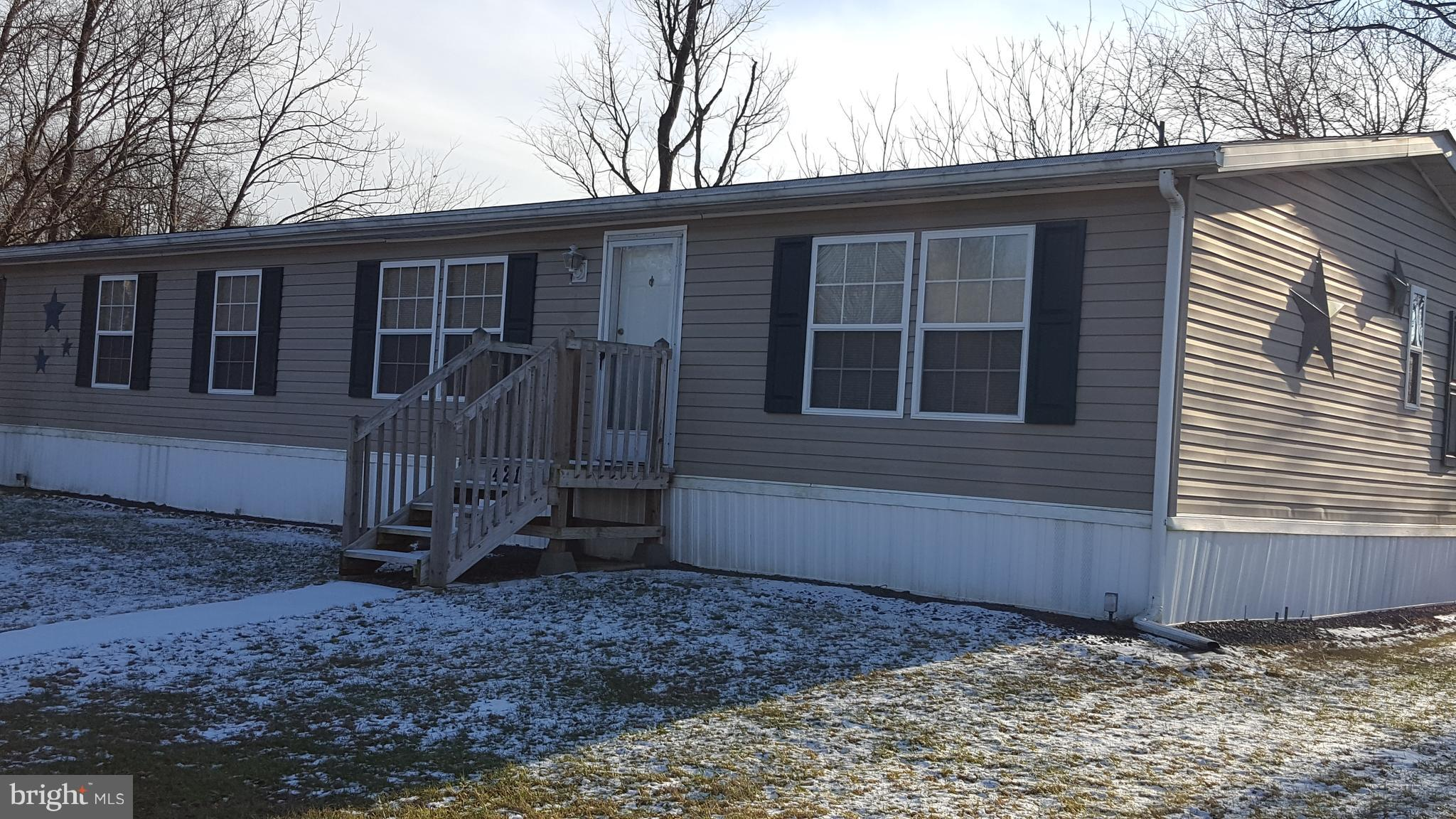 3 bedroom double wide on great end of road lot, off street parking, side covered porch. 1st floor office/den and laundry, propane hear with central ac all appliances included. Lot rent is $470.00. Includes water,sewer, trash, recycling.