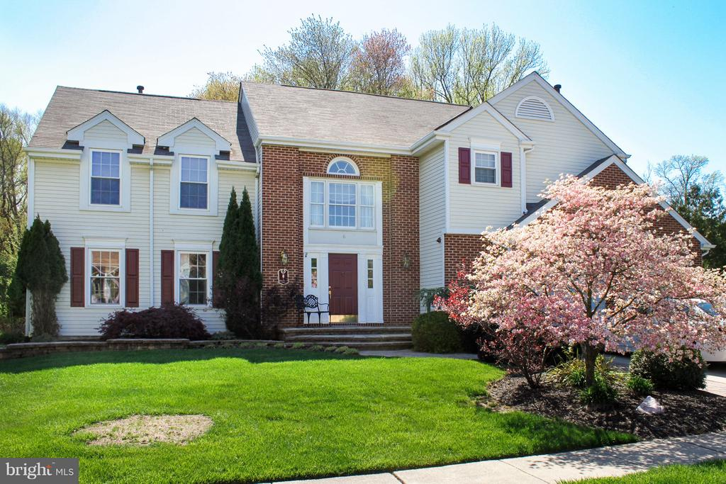 Gorgeous home situated in one of Mount Laurel's finest neighborhoods Laurel Knoll East.  Minutes away from major highways to give easy access to Philadelphia or north to New York.  As you pull up to this professionally manicured lawn with great curb appeal you will be anxious to see what more this home has to offer.  You will enter a two story foyer with custom paint, hard wood floors and staircase.  This open floor plan allows you to view the formal living room and family room which is delightful for holiday entertaining.  The large custom kitchen has stainless appliances, stone back splash, granite countertops, double sink, cook top range, microwave, with a center island. French doors in the kitchen lead out to a large custom deck.  A formal dining room sits off the kitchen with crown molding, neutral paint and some custom wood work.   A two story family room sits off the kitchen with a gas fireplace, custom paint, and neutral carpet giving you a warm and inviting feeling.  Pass through french doors to the most wonderful 600+ addition.  This amazing custom built addition supplies all your entertaining needs with hardwood floors, indoor outdoor surround sound, recessed lighting, palladium windows, bar area, and separate heating and air conditioning. All leading to the custom deck and private wooded backyard.  The second level of living has a master bedroom with a separate sitting room. A large master bath with double sink vanity, garden tub, and separate shower area. The suite also has a large walk in closet with custom shelving, and walk in attic for added storage.  Three additional large bright bedrooms and a main bath with a double vanity sink complete the second level.  Other amenities of this fine home include newer roof, newer windows, security system, attic fan, newer hot water heater, newer 3-zone heating and air conditioning systems, newer garage doors, sprinkler system, and an outdoor shed.  The list goes on and on.   Your search will end for your forever home once you walk through the door.  This Beautiful home is just shy of 3500sq ft.