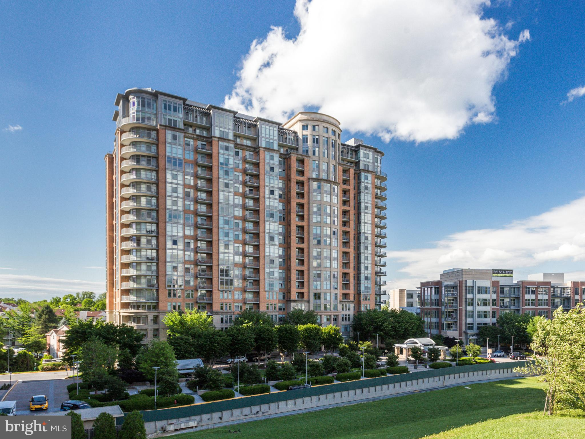 OPEN HOUSE SUNDAY - FEBRUARY 24TH FROM 2 PM TO 4 PM.  For Sale in luxury One Park Crest condominium:  A Large, East oriented Corner Unit with panoramic views.  Unit has 1,612 square feet of indoor space, plus a wide circular Wraparound Balcony.  The Two Master Bedrooms have attached Full Baths and large Walk-in Closets.  Entry Foyer has Coats Closet, Den and Half-Bath.  Living and Dining areas have Floor to Ceiling windows.  The Sr. Master Bedroom also has Floor to Ceiling windows!  Sr. Master Bathroom has Dual Sink Granite Countertop, Marble Floor, Large Shower and Soaking Tub!  2nd Master Bathroom has Shower and Granite Sink Countertop.  GE Stainless Steel Appliances and Granite Countertops in Kitchen.  Unit enjoys abundant morning and day long sunshine with nice views of the expanding Tysons skyline from Capital One to The Boro to the East and South, and of Sugarloaf mountain and Maryland to the North.  The Wraparound Balcony is great for outdoor enjoyment in good weather.  Unit conveys with TWO Parking Spaces adjacent to each other on P2 level.  Parking Space numbers P2-116 and P2-117.  One Park Crest has an ornate Lobby and common area on first floor that include a meeting room, exercise room, courtyard and two guest suites available to guests of building residents for a nightly rate.  The amenities continue on 18th floor with a swanky Club Room, Roof Top Deck and Pool - That altogether offer sweeping views of the growing Tysons City skyline and of the Shenandoah mountains with gorgeous year-round sunsets.  The Park Crest Master Association has 24x7 Harris Teeter grocery store and Starbucks Coffee shop immediately next door.  One Park Crest is 0.9 miles from Tysons Corner Silver metro rail station.  Investor Buyer:  Monthly rent can exceed $4,200 and is stable due to high demand in greater Tysons for such large unit rentals.  Overall, a great opportunity to own 1,612 sq. ft. on 7th floor of an iconic luxury high rise in the heart of Tysons for a very reasonable