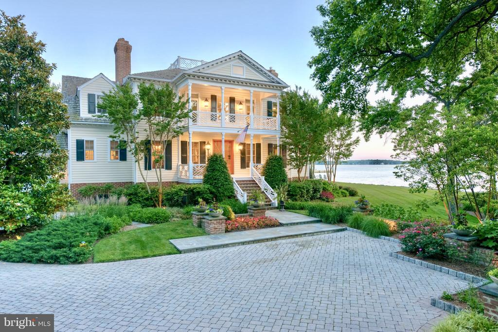 """RARE OPPORTUNITY TO OWN ONE OF THE FINEST WATERFRONT ESTATES IN ANNAPOLIS.  GRACIOUSLY SITED ON  .94 ACRES IN A PRIVATE AND SECLUDED LOCATION, THIS SOUTHERN COLONIAL IS A """"TEN!""""  YOU WILL LOVE THE AWARD WINNING INFINITY EDGE POOL, SPA, OUTDOOR KITCHEN & STONE FIREPLACE. 200 ' OF RIP RAPPED SHORELINE WITH UNOBSTRUCTED VIEWS OF THE SOUTH RIVER.  AMAZING SUNSETS.  APPROXIMATELY $1 MILLION IN IMPROVEMENTS SINCE 2005, INCLUDING A BRAND NEW ROOF & EXQUISITE NEW BATHS.  GOURMET KITCHEN, DRAMATIC """"STEP DOWN"""" GREAT ROOM W/ A WALL OF WINDOWS W/ NEW AUTO SHADES & BRICK FIREPLACE.  FORMAL LIVING &  DINING ROOMS  W/ FIREPLACES AND TASTEFULLY APPOINTED MOLDINGS & TRIM.  EXTENSIVE NIGHT LIGHTING, AND PROFESSIONALLY LANDSCAPED W/ AN UNDERGROUND SPRINKLER SYSTEM.  COZY OWNERS SUITE W/ SITTING RM W/ WOOD STOVE, 3 WALK IN CLOSETS, AND FABULOUS CUSTOM FULL BATH. 5TH BEDROOM COULD BE NANNY/INLAW SUITE OR 2ND FAMILY ROOM.  BRICK PATIO &  VERANDA OVERLOOKS PEACEFUL WATERFRONT SPLENDOR. OVER SIZED TWO CAR GARAGE W/ PAVER DRIVEWAY WITH ROOM FOR 5/6 CARS.   NO EXPENSE SPARED OR DETAIL OVERLOOKED.  IDEALLY LOCATED IN A HIGHLY SOUGHT AFTER COMMUNITY OF FINE HOMES JUST MINUTES TO DOWNTOWN HISTORIC ANNAPOLIS & MAJOR COMMUTING ROUTES.   COMMUNITY OFFERS WATERSIDE POOL, MARINA W/ SLIPS & BOAT RAMP, & TENNIS COURT.  SEE VISUAL TOUR......  SHOWN BY APPT ONLY."""