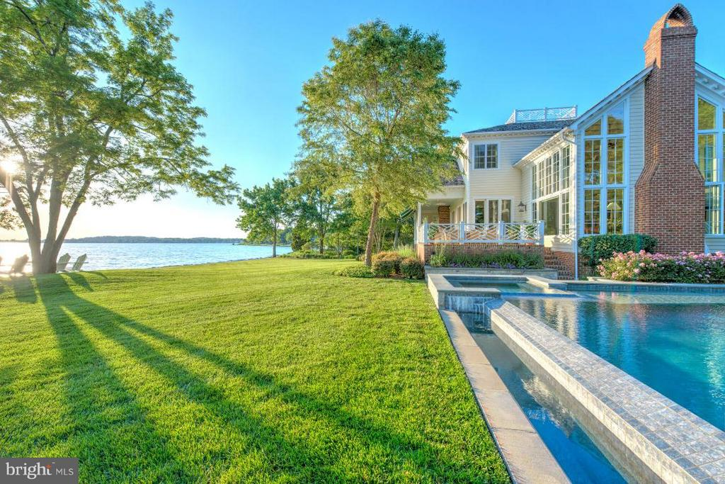"NEW AGGRESSIVE PRICE... ONE OF THE FINEST WATERFRONT ESTATES IN ANNAPOLIS CAN BE YOURS!  GRACIOUSLY SITED ON  .94 ACRES IN A PRIVATE AND SECLUDED LOCATION, THIS SOUTHERN COLONIAL IS A ""TEN!""  YOU WILL LOVE THE AWARD WINNING INFINITY EDGE POOL, SPA, OUTDOOR KITCHEN & STONE FIREPLACE. 200 ' OF RIP RAPPED SHORELINE WITH UNOBSTRUCTED VIEWS OF THE SOUTH RIVER.  AMAZING SUNSETS.  APPROXIMATELY $1 MILLION IN IMPROVEMENTS SINCE 2005, INCLUDING A BRAND NEW ROOF & EXQUISITE NEW BATHS.  GOURMET KITCHEN, DRAMATIC ""STEP DOWN"" GREAT ROOM W/ A WALL OF WINDOWS W/ NEW AUTO SHADES & BRICK FIREPLACE.  FORMAL LIVING &  DINING ROOMS  W/ FIREPLACES AND TASTEFULLY APPOINTED MOLDINGS & TRIM.  EXTENSIVE NIGHT LIGHTING, AND PROFESSIONALLY LANDSCAPED W/ AN UNDERGROUND SPRINKLER SYSTEM.  COZY OWNERS SUITE W/ SITTING RM W/ WOOD STOVE, 3 WALK IN CLOSETS, AND FABULOUS CUSTOM FULL BATH. 5TH BEDROOM COULD BE NANNY/INLAW SUITE OR 2ND FAMILY ROOM.  BRICK PATIO &  VERANDA OVERLOOKS PEACEFUL WATERFRONT SPLENDOR. OVER SIZED TWO CAR GARAGE W/ PAVER DRIVEWAY WITH ROOM FOR 5/6 CARS.   NO EXPENSE SPARED OR DETAIL OVERLOOKED.  IDEALLY LOCATED IN A HIGHLY SOUGHT AFTER COMMUNITY OF FINE HOMES JUST MINUTES TO DOWNTOWN HISTORIC ANNAPOLIS & MAJOR COMMUTING ROUTES.   COMMUNITY OFFERS WATERSIDE POOL, MARINA W/ SLIPS & BOAT RAMP, & TENNIS COURT.  SEE VISUAL TOUR......  SHOWN BY APPT ONLY."