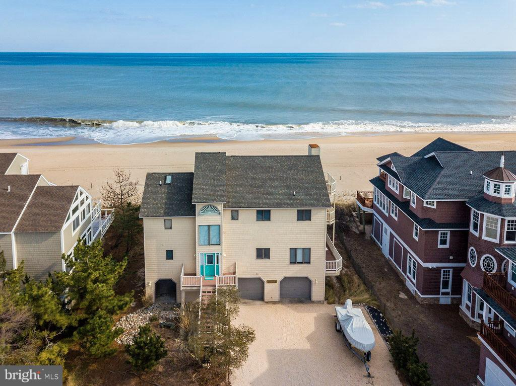 JUST REDUCED.  A rare find in North Bethany... Direct oceanfront home with private beach access, located in the prestigious gated community of Bayberry Dunes. Enjoy unobstructed sunrise views and fireworks on 4th of July from your back deck. Ride your bike into the town of Bethany just a few minutes away and take advantage of restaurants, shopping and the boardwalk. This ample size home has room for the entire family, two master suites with private bathrooms, along with three other spacious bedrooms and two more full baths. Everyone will enjoy the large loft space on the fourth floor, suitable for extra sleeping room or a game room. The open concept main floor is the perfect space for entertaining. The living area, kitchen, and dining room feel like they are sitting on-top of the blue Ocean, with views from every angle. Ownership has stayed within one family and is rented only a few weeks in the Summer months. Home is in exceptional shape and shows pride in ownership. There is potential for $10K a week in the Summer months. Call today for a private showing on this gorgeous oceanfront home, and your beach experiences will never be the same. Buyers must comply with the rentals in place through itrip.