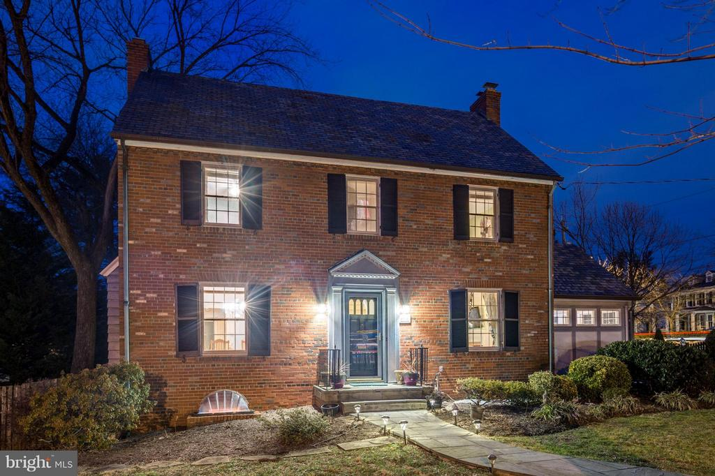 FANTASTIC NEW PRICE 3/7! Now priced BELOW OWNERS COST!  Sun-filled, freshly painted brick colonial ideally located on a large corner lot with tons of usable front, side and backyard space in sought after Chevy Chase Village. Blocks to shops, restaurants and public transportation.  Updated kitchen with pantry, large dining & living rooms, private main level office and separate den/bonus room. Owner's Suite features a renovated bath with luxurious spa shower and vanity with double sinks, plus walk in closet and two additional large bedrooms and a hall bath complete the upper level.  Finished 3rd level attic offers a 5th bedroom area or playroom, craft space or hangout.   The lower level is replete with large fam/recreation room with fireplace, exercise room, bedroom, and full bath. Lower level walkup to rear deck & patio overlook the large, flat fenced yard.  Room for expansion! Swingset is negotiable! 2 car detached garage with storage space add to this fabulous home.
