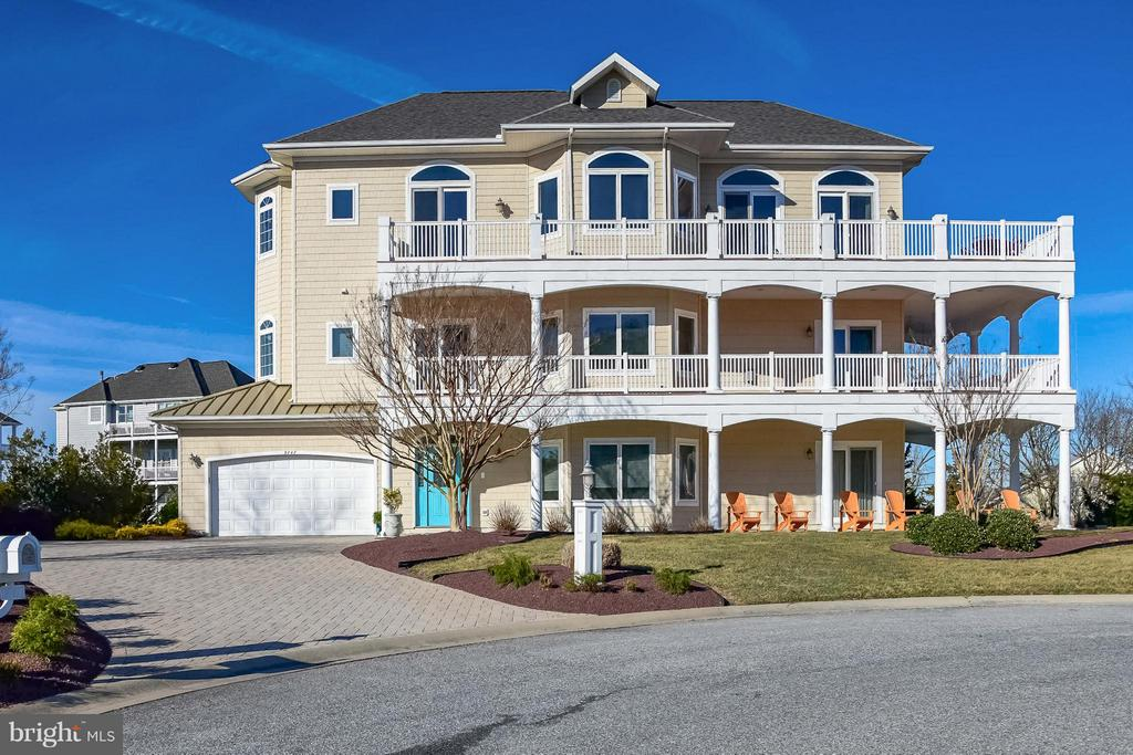 Luxurious 5BR/5 BA home in the prestigious neighborhood of  Martha's Landing in desirable West Ocean City hits the market.  This home has views of the Bay, the inlet and the Boardwalk, and has an elevator and a two car garage!  This home has breathtaking water views throughout and is being sold fully furnished.  As you walk into the home you see the fabulous decor, attention to detail and exceptional craftsmanship with custom finishes throughout. This is the perfect floor plan for large families and for entertaining  guests.  On the first floor there is a large great room with wonderful kitchen and a spacious bedroom and full bath.  On the second level you will find a spacious oversize master bedroom with his and her closets, a fireplace and a glass slider leading to a beautiful wrap around deck.  There are also two addition bedrooms each with a full bath.  On the third level you will find yet another large bedroom and bath.  The professional chefs kitchen is sure to please the cook in your family.  There is plenty of storage and a large center island complete with granite countertops. The large dining area is off the kitchen and is perfect for enjoying dinner with family and friends. The large great room extends to the deck where you will enjoy endless sunsets and views of the inlet, the Bay and the boardwalk.  The house also has a two car garage, a fire sprinkler system, wrap around decks, a paver driveway and an elevator.  This home was constructed by Piney Island Builders.  (HOA - pays for grass cutting and use of pool at Sunset) Come take a look at this incredible home today and make it yours!