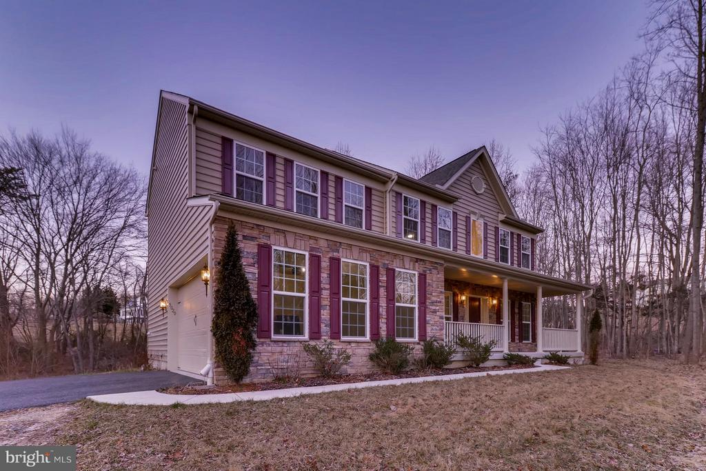 PRICE REDUCTION! This is an absolutely stunning 5 bedroom/3.5 bathroom detached home in Perry Hall. Sits on a 1.77 Acre lot and is secluded from the nearby roads. Walk in to a huge open floor plan with 2 story ceilings and tons of windows for natural sunlight. Spacious kitchen with beautiful granite counter tops, a large island, tons of cabinetry, and table space. On the main level is a formal dining room off of the kitchen, very spacious living room to relax, and another gathering room. Absolutely huge master bedroom w/ 2 massive  his and hers walk-in closets and a double vanity master bathroom, which also holds a spacious soaking tub and separate glass shower. The upper level along with the master bedroom holds 3 beautiful  extra bedrooms with plenty of closet space. Ginormous basement with a fifth bedroom, huge utility/storage space, and a in-law suite!  NO HOA FEE!! This beautiful stone exterior home comes with an attached 2-car garage with a minimum of 2 EXTRA parking spaces on the long entry driveway. This is an absolute dream home that you do not want to miss out on! Come by and see for yourself!