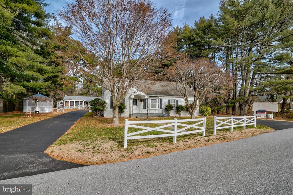 Price Reduced! Prime location for a home occupation in West Ocean City, Maryland on Rt. 50 only 2.5 miles from Ocean City. Opportunity abounds on 1.59 acres with a 2,227 sq. ft. 3 bedroom 2 bathroom home, 1,030 sq. ft. workshop/retail store, 1,298 sq. ft. barn/store and generous storage shed. The property has high visibility with signage and is located at an intersection with a stop light.  Featuring ample paved parking, gardens and a pond. Turn your home into a money-making property with a short commute and take advantage of possible tax benefits. Home/Business/Retail. For sale in as is condition. Formally Edgemoor Antiques Business.