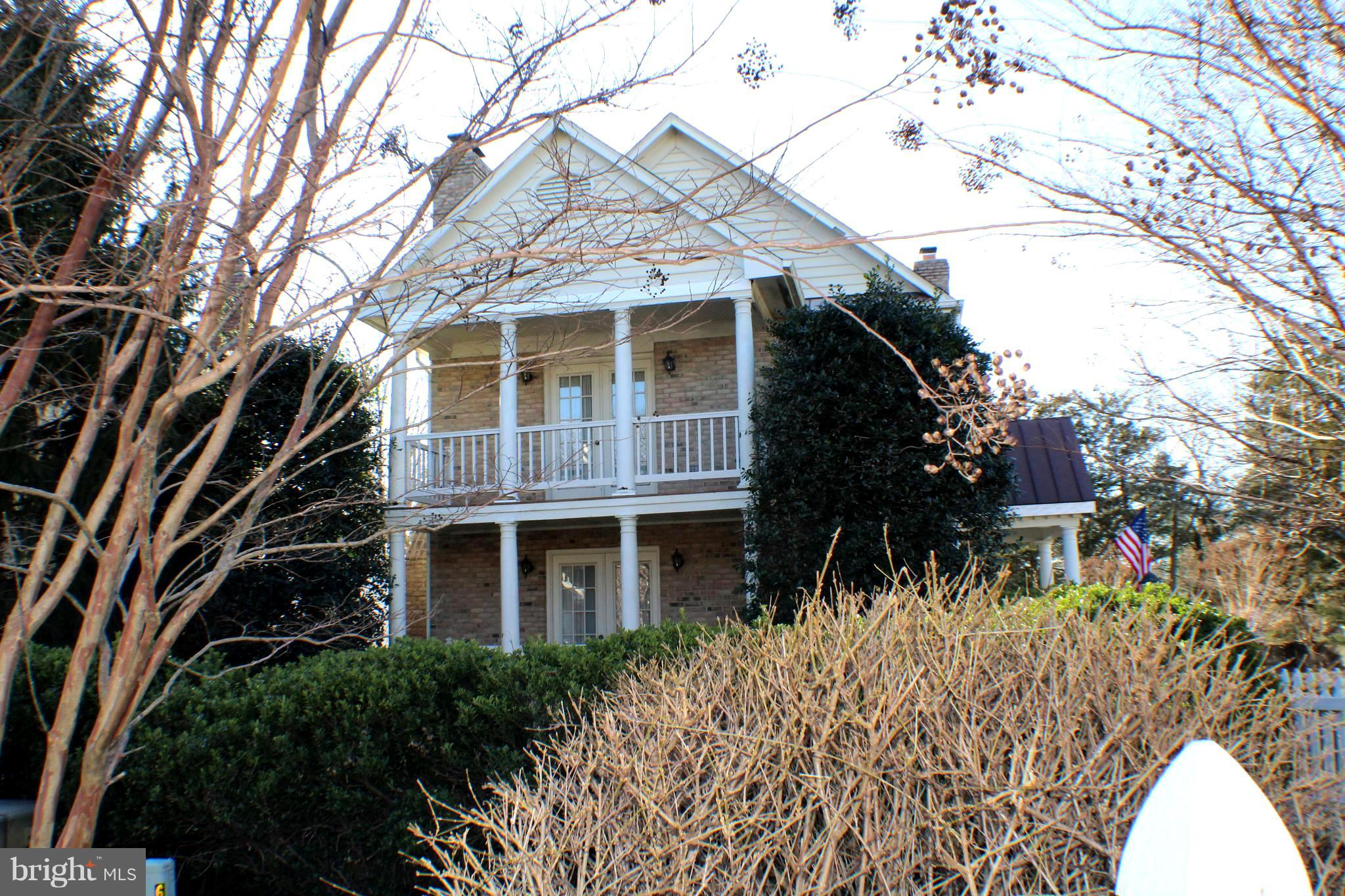 Price reduced $25,000! Walk to Metro and Springfield Mall from this beautifully maintained Colonial in the Southern Tradition of Charleston! Need to close in 30 days? We'll work with you to make sure it happens!  New carpet just installed! Enjoy the professionally landscaped setting, the white  fenced English front garden and the double front porches accessed from the Living Room or Master Bedroom.  There is a side porch for driveway access and a private rear Trex deck for casual relaxation. This home is the third largest property in the New Charleston Collection. Inside, please find a spacious and open 3-level floor plan (2,700 sq ft)  with living room and fireplace adjacent to a dining area which then leads to a large breakfast and family room combo with yet another fireplace. There are three bedroom upstairs - French doors to the balcony from the MBR with a walk-in closet and large bath/shower combo. The fourth bedroom and third full bath is in the lower level as part of an in-law suite and a family room with fireplace. Parking and nearby points of commuting interest- Walking distance to new Springfield Town Center and Franconia,Springfield Metro, Near new upcoming TSA Headquarters, just Four Metro stops to National Airport and Five Metro stops to upcoming Amazon Headquarters. Detached two car garage and extended driveway for more parking. Yes, some updates could be completed, but that is reflected in the price reduction. The house otherwise shows beautifully and is in move-in condition.