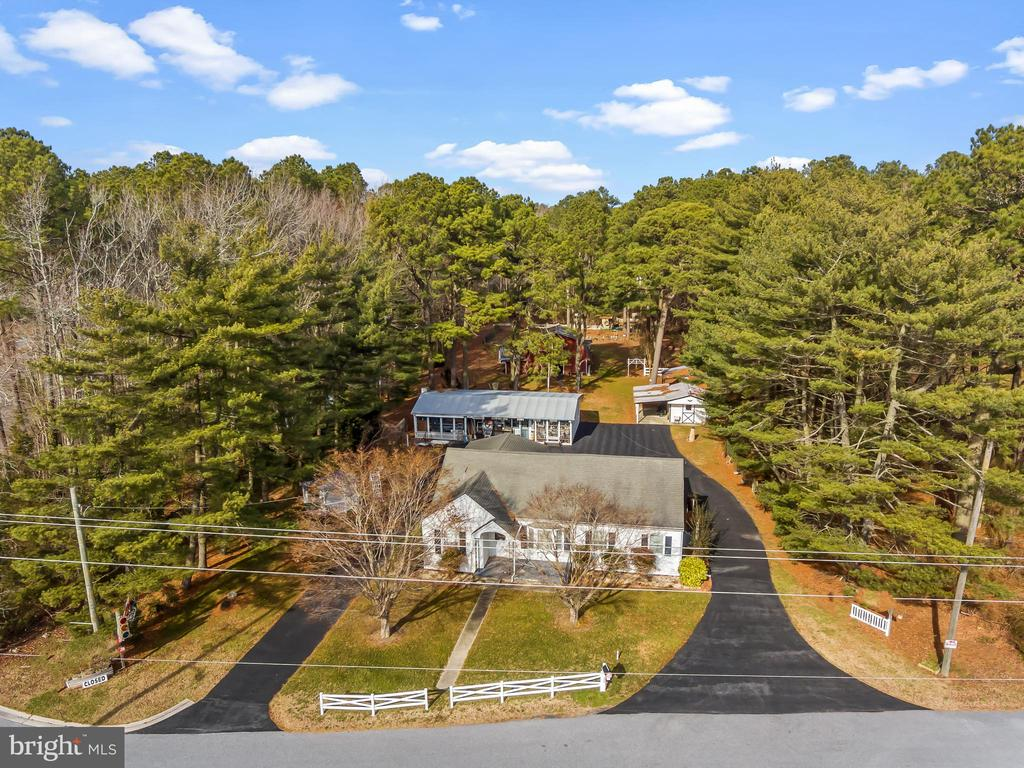 Price Reduced! Prime location for a home occupation in West Ocean City, Maryland on Rt. 50 only 2.5 miles from Ocean City. Opportunity abounds on 1.59 acres with a 2,227 sq. ft. 3 bedroom 2 bathroom home, 1,030 sq. ft. workshop/retail store, 1,298 sq. ft. barn/store and generous storage shed. The property has high visibility with signage and is located at an intersection with a stop light.  Featuring ample paved parking, gardens and a pond. Turn your home into a money-making property with a short commute and take advantage of possible tax benefits. Home/Business/Retail. For sale in as is condition. Formally Edgemoor Antiques.