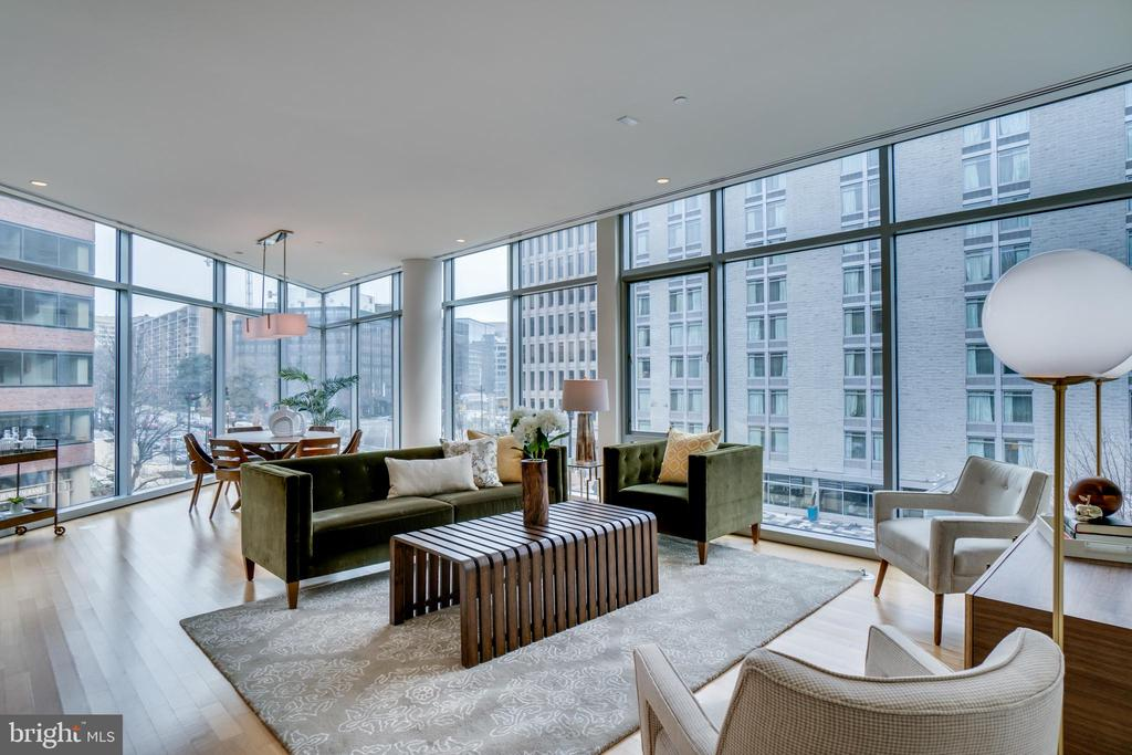 Truly stunning apartment on the coveted point of 22West with walls of floor-to-ceiling windows. 2BR+Den (possible 3rd bedroom)/3 full baths. 2-car parking plus storage.  Building has 24-hr front desk concierge, rooftop pool and sundeck, party room, and fitness room.