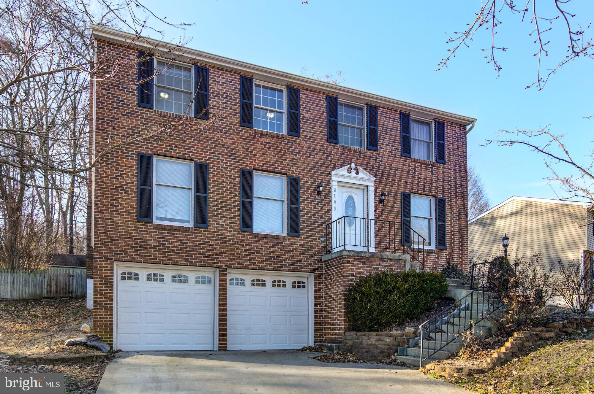 Beautiful Brick Front Colonial with Two Car Garage!  Main level features Wood Floors! Freshly Painted Throughout!  New Carpet in Bedrooms and lower level! Kitchen fully updated and upgraded in 2018 features Stainless Appliances, Granite Counters, and Custom Cabinets! Main level with living room, dining room, Kitchen with breakfast area and opens up to Great Room with Fireplace.  Upper level features Four Large Bedrooms and Two Full Bathrooms. Walk-in closet in Master Bedroom.  Finished lower level.  Oversized Two Car Garage! New Siding in 2017.  Captivating rear fenced yard and fire pit!
