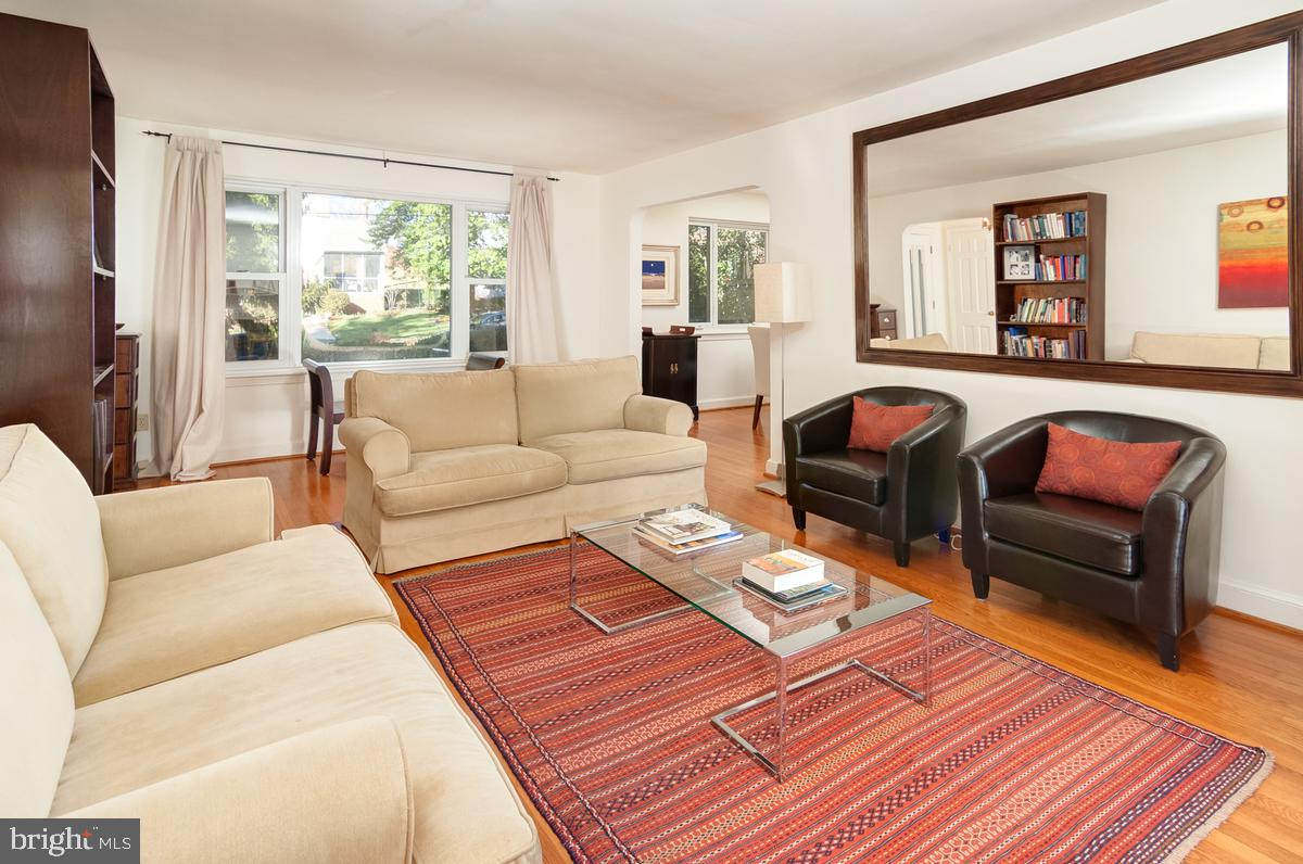 Priced for a quick 30-day closing, this lovely brick home is nicely set back from its quiet, tree-lined street. Originally built in 1951, the brick and clapboard Rambler offers lots space, including a family room addition, perfect for entertainment. Just off Mass Avenue in desirable Bethesda, this charmer is surrounded by mature trees and boasts abundant curb appeal.Beautiful hardwood floors run throughout the main level, bathed by natural window light and complemented by wainscoting. A fireplace in the living room will warm your winter nights and a huge outdoor deck will add to summer fun. Built-in glass cabinets frame the dining room bay with its classic vintage windows. With three bedrooms, 2.5 baths and a finished basement, this place has room to spare.An updated kitchen features beautiful countertops, gas range, tile floors, custom cabinets and windows on two sides.~~A family room addition with vaulted ceiling and exposed brick wall is the perfect place to study, play games or watch TV. The finished basement lends even more fun possibilities! Also worth noting are the two-car garage and potential for remodeling or expansion. Location is also key: strolling distance to Westmoreland Park and Wood Acres Elementary, and just a dozen blocks from the Potomac River.