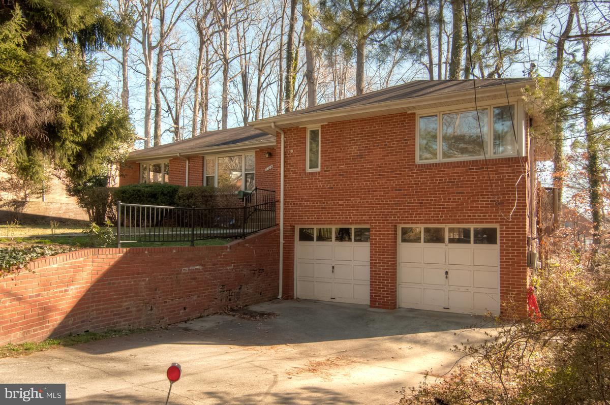 Your Chance to Build Equity Is Here! Sieze the opportunity to own this lovely brick home in a quiet, tree-lined street. Originally built in 1951, the brick and clapboard Rambler offers lots of space, including a family room addition, perfect for entertaining. Just off Mass Avenue in desirable Bethesda, this charmer is surrounded by mature trees and boasts abundant curb appeal. Beautiful hardwood floors run throughout the main level, bathed by natural window light and complemented by wainscoting. A fireplace in the living room will warm your winter nights and a huge outdoor deck will add to summer fun. Built-in glass cabinets frame the dining room bay with its classic vintage windows. With three bedrooms, 2.5 baths and a finished basement, this place has room to spare.An updated kitchen features beautiful countertops, gas range, tile floors, custom cabinets and windows on two sides.~~A family room addition with vaulted ceiling and the exposed brick wall is the perfect place to study, play games or watch TV. The finished basement lends even more fun possibilities! Also worth noting are the two-car garage and potential for remodeling or expansion. Location is also key: strolling distance to Westmoreland Park and Wood Acres Elementary, and just a dozen blocks from the Potomac River.