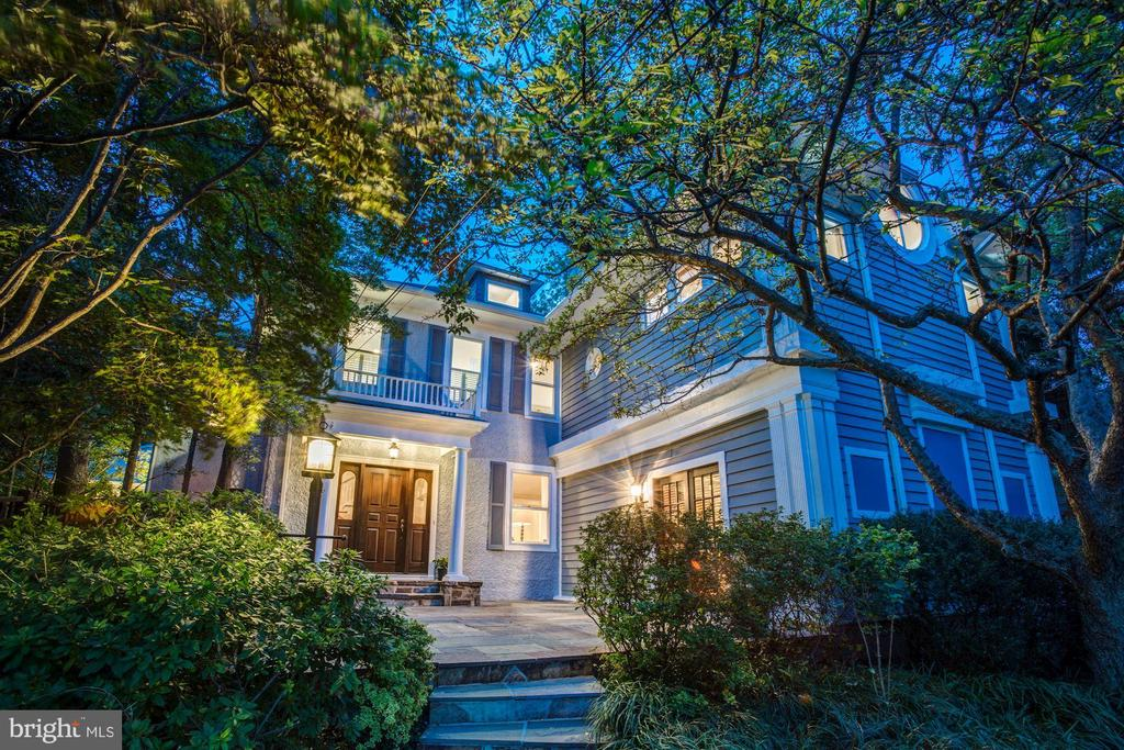 Rare opportunity to buy one of the original Arlington early 1900s homes, completely renovated and restored with quality construction and attention to detail. Handsomely sited on one of the highest points in Arlington, surrounded by dense and mature trees and beautiful landscape architecture. The 2/3-acre site features a 3-car garage, oversize carport, and additional off-street parking. Located on a quiet non-through street with sweeping views overlooking the Washington Golf Country Club, the home is conveniently located near the GW Parkway, 95, 66, and the beltway for easy commuting to DC, Tysons Corner, and all the surrounding areas. This architect designed and expanded residence features almost 6,000square feet of completely updated living with6 bedrooms and 5.5 baths. Main level offers endless space to entertain with a huge main kitchen, a second entertaining kitchen, living room, family room, sunroom, screened in porch, and library. The spacious owner's suite features an impressively large port window alongside a comfortable sitting room with fireplace, build-in closets, and a large ensuite bath. All secondary bedrooms are generously sized with ample closet space and natural light. Additionally, the home features tucked away loft space with exposed beams and ensuite bath.The lower level basement includes an isolated space for an au pair suite or gym and a separate cellar which includes additional storage, utility, and closet spaces.Other unique features include a crow~s nest with views of DC.