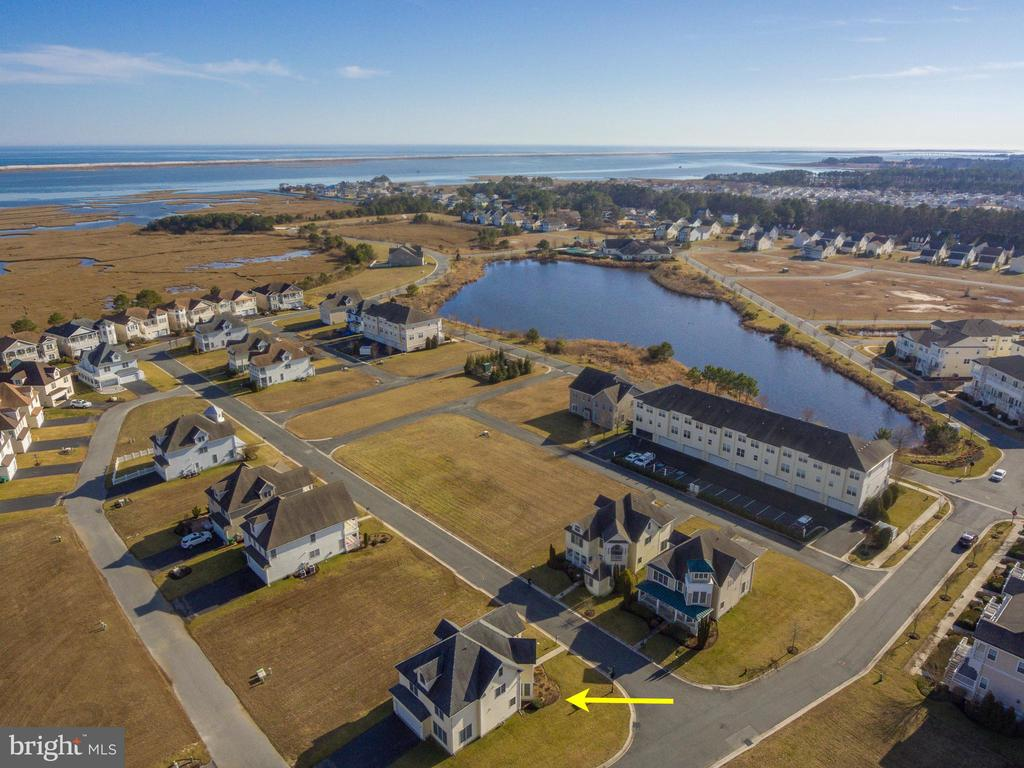 Custom built home on a corner lot with a 2 car garage located in Bayside Ocean City; a luxury amenity- filled community minutes to the Beach, Boardwalk, Historic Berlin, Golfing and Assateague Island. This spacious home features 9~ft. ceilings, a bedroom and a full bathroom on the 1st floor. The living room has plenty of natural light, cathedral ceilings, a gas fireplace, hardwood floors that all open to the generous kitchen with abundant cabinet space, counter seating and dining area. On the 3rd floor enjoy a finished second family/bonus room with a full bathroom. This home is fully furnished and turnkey ready to move in. Recreation for the outdoor enthusiasts includes a crabbing pier, kayak storage with launching area, tennis courts and playground. Additional amenities include a clubhouse, indoor and outdoor pool, exercise room and billiard room. Excellent rental income.