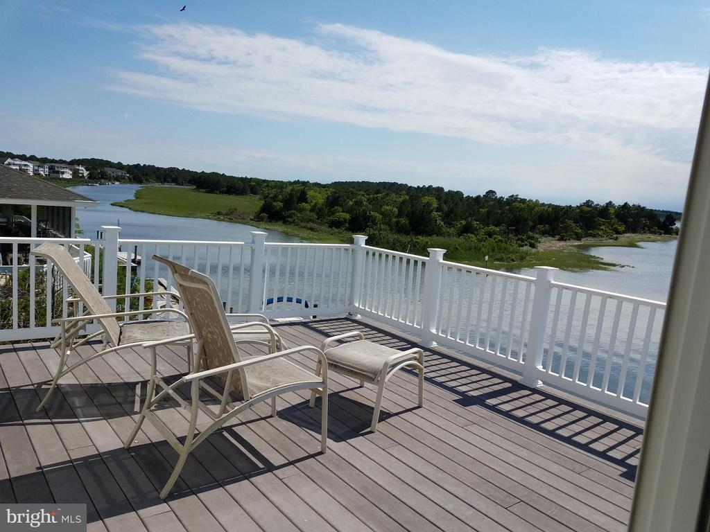 Large 4 BR, 3.5 Bath Bayfront Home, Located in Cotton Patch Hills, Panoramic Bayfront Views &, Beautiful Sunsets, Enjoy the Peaceful Atmosphere of Beach Cove, while watching the Heron, and  Osprey on Nesting Stands. Open Floor Plan, Spacious Rooms. Den, Small Office off  MB, 2 MB'S, with whirl pool tubs and double vanities, wide stairway,LG. Foyer, Laundry Room, Lg. Owners Closet, Granite Counter Tops, Gas Range, Screened Porch, Several Bay Front Decks & Balconies, Outside Shower, Stairway to Floored Attic, Storage Sheds under the house.,, Bulkhead/ Riprap, Boat Dock. Community Ramp, Marina, Tennis Court  and only 3 blocks to Private Life Guarded Ocean Beach. Short Distance to Rehoboth, Bethany Beach, Restaurants, Scenic Indian River Bridge and Inlet. Fully Furnished & Turn Key. Great Rental Potential