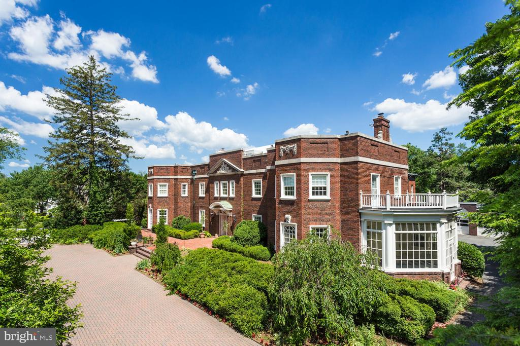 Historic estate located in the heart of Chevy Chase, over 100 years of storied history. This 1.36 acre/13,000+ SQFT property has 10BR/9.5 BA. Features incl. beautiful renovated kitchen, ballroom with 12' ceiling, spacious master suite, swimming pool, 3-car garage & parking for +/- 15 cars. Located less than a half mile from the District line, walkable to downtown Bethesda.